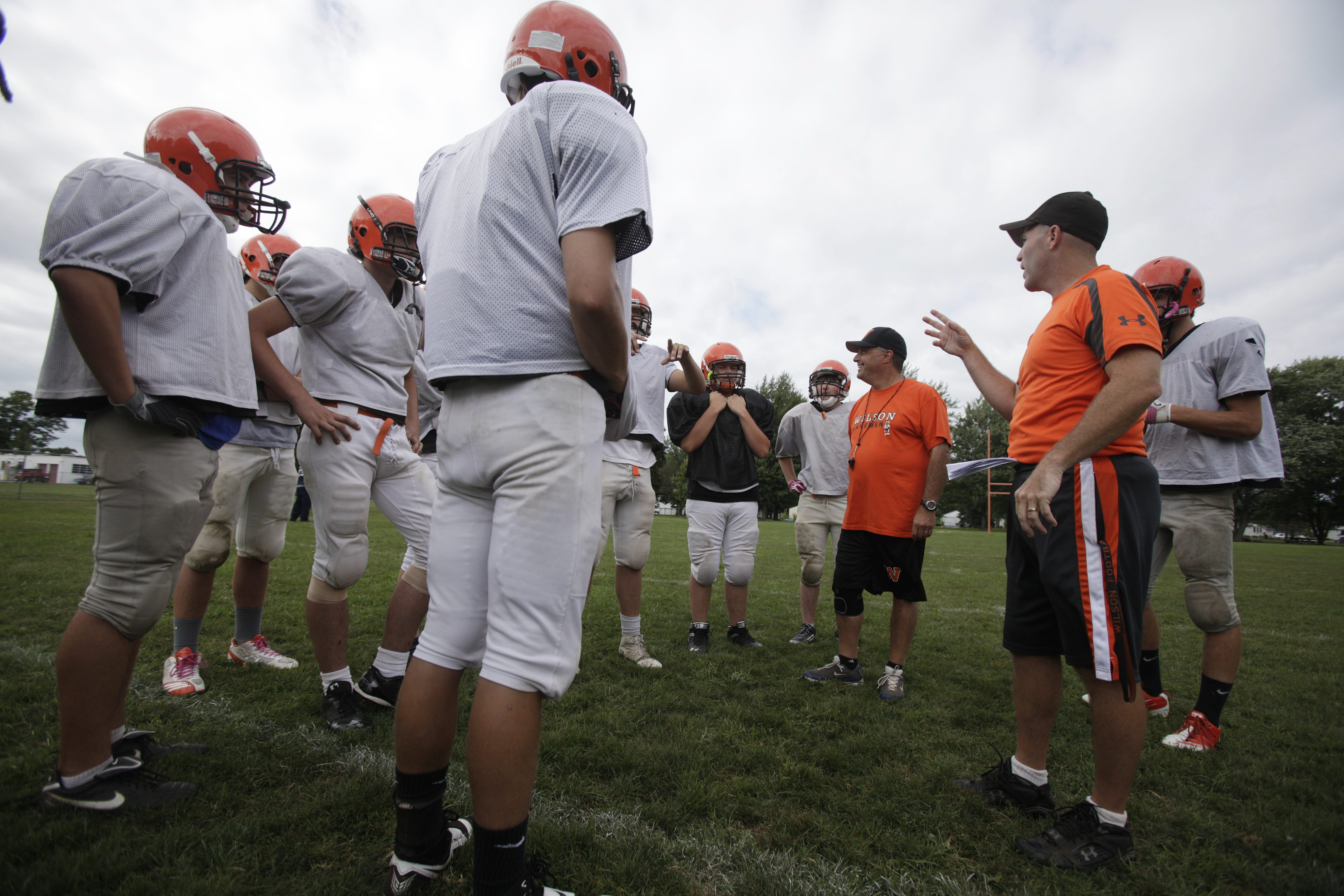 Wilson football head coach William Atlas, right, and defensive coordinator Al Scarpine, left,  talks with their players during practice at the school in Wilson Tuesday, September 3, 2013.  (Mark Mulville/Buffalo News)
