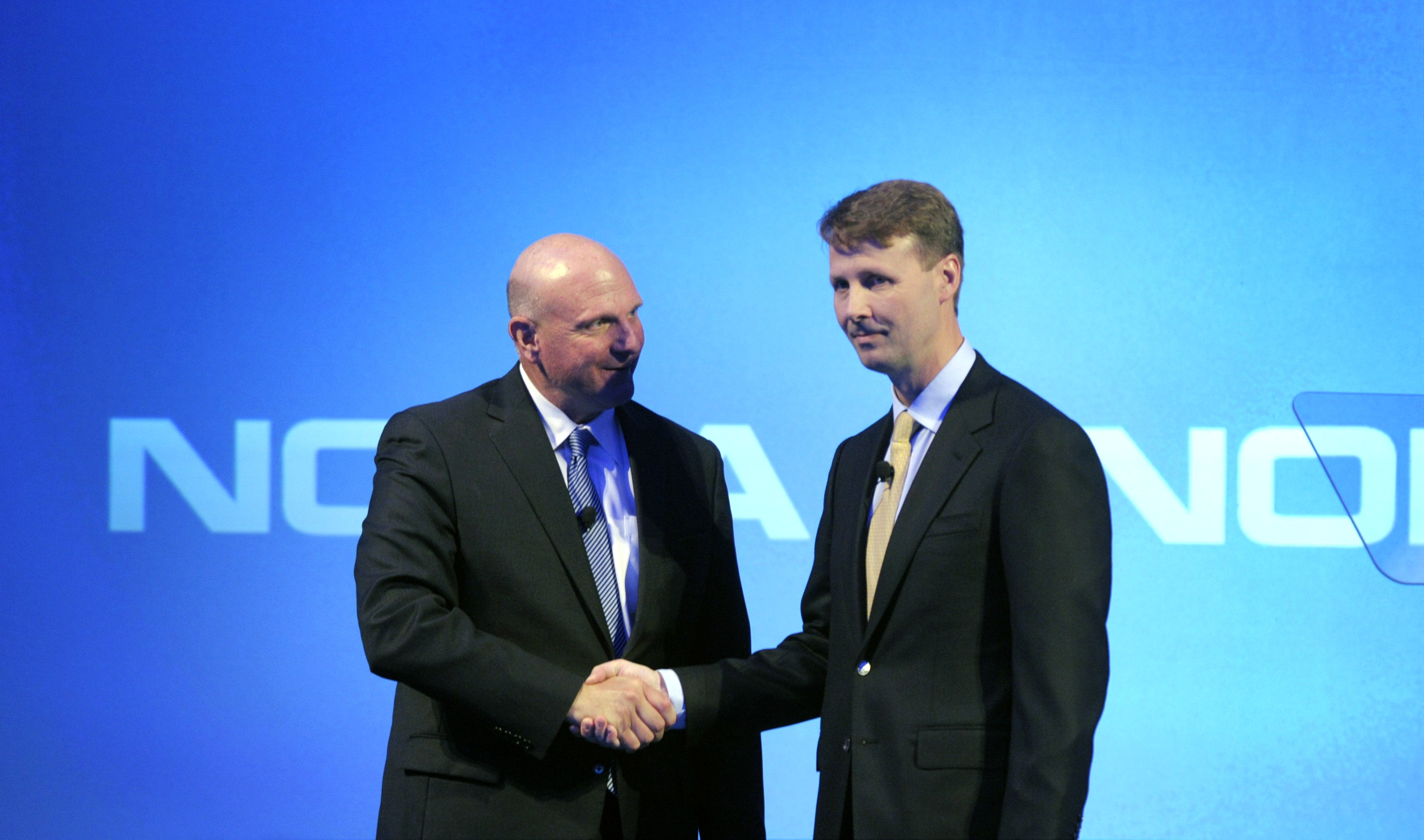 Microsoft CEO Steve Ballmer, left, shakes hands with Nokia's board Chairman Risto Siilasmaa.