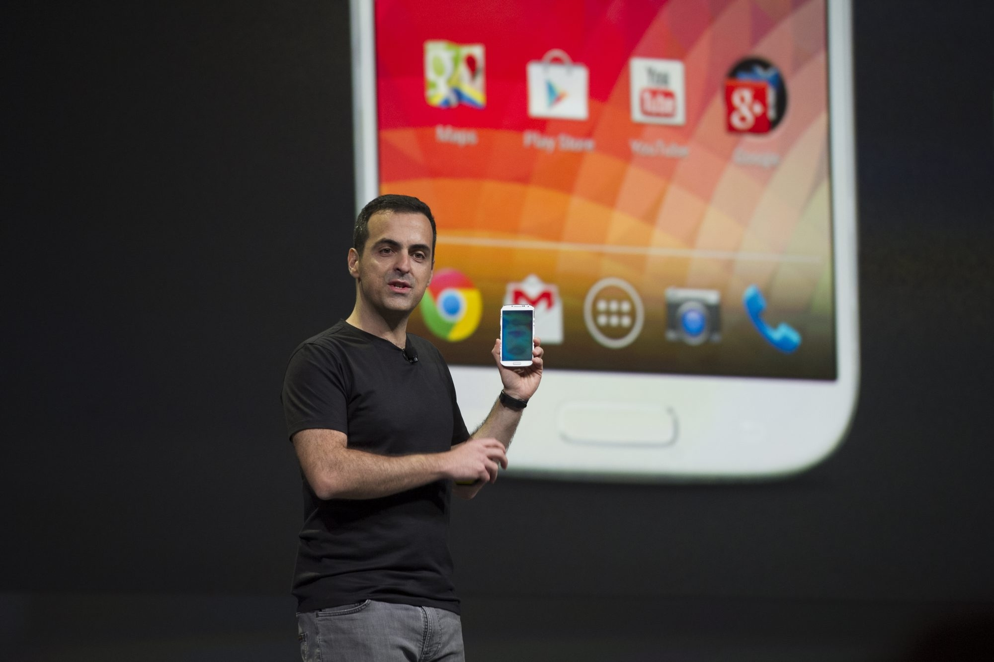 Hugo Barra, vice president of product management for Android at Google Inc., holds a Samsung Galaxy S4 Google Edition phone while speaking at the Google I/O Annual Developers Conference in San Francisco. Google's open software can make the phones vulnerable to hackers.