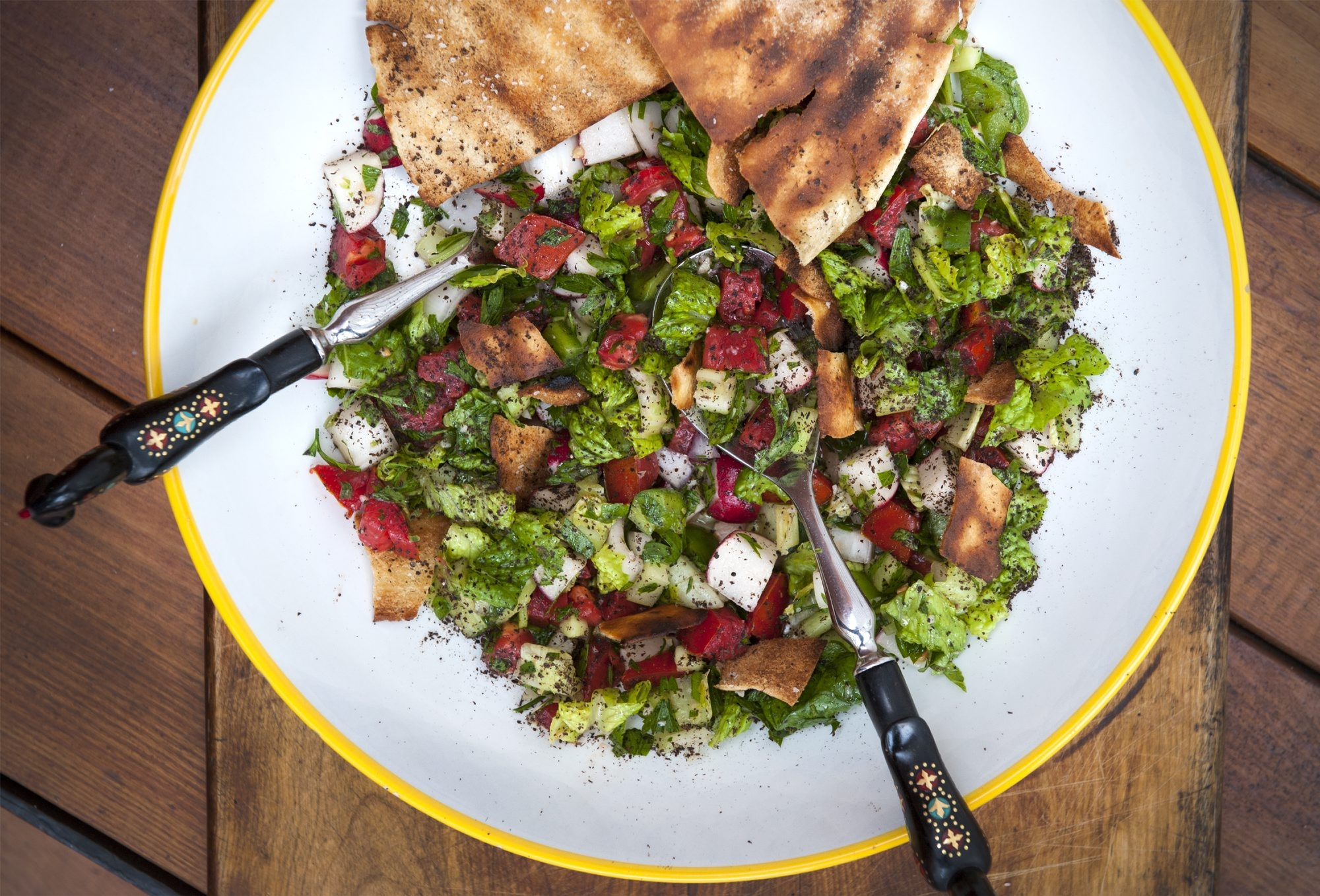 The crunch of the grilled pita gives this chunky and colorful fattoush its character.