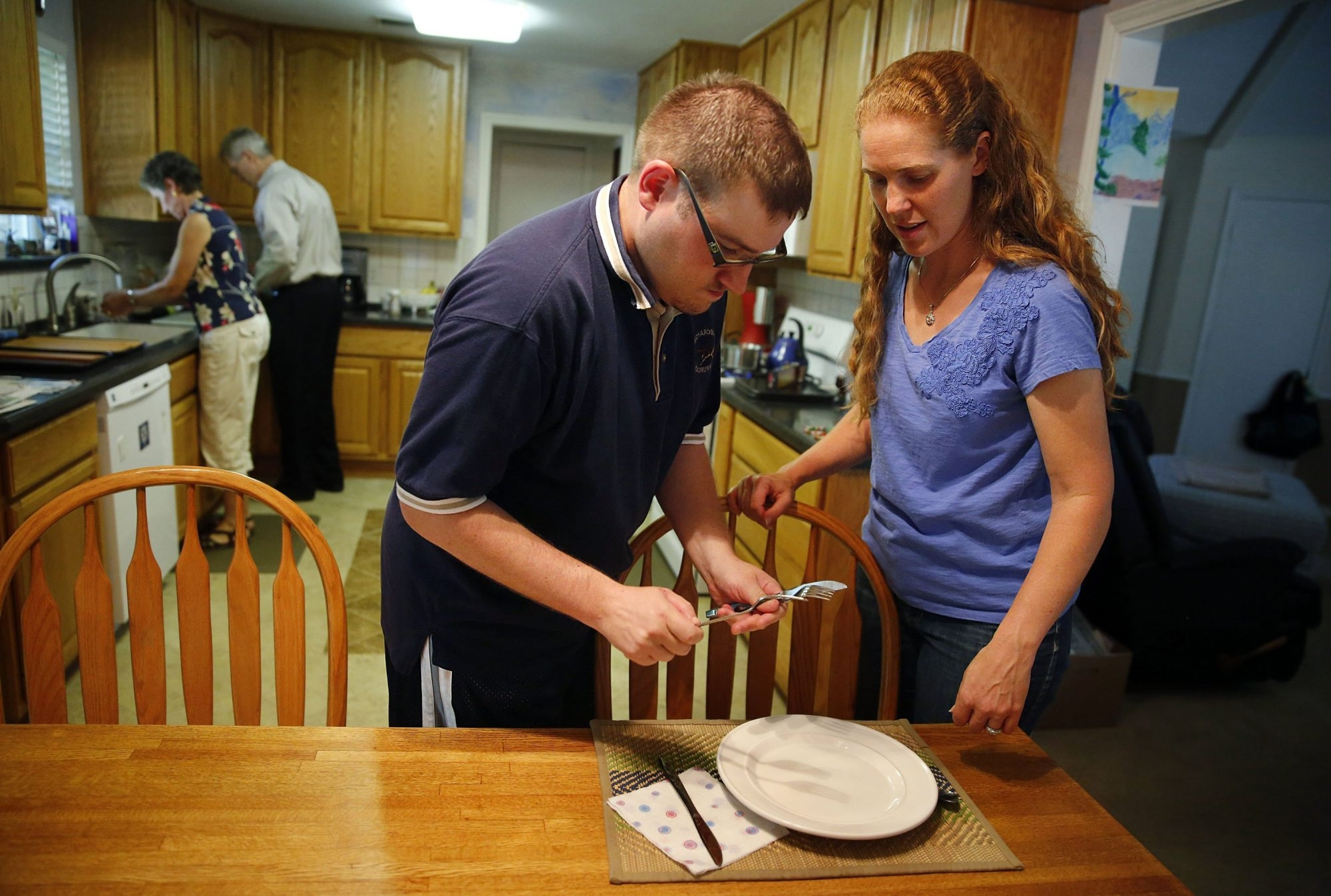 Mandy Dockweiler helps care for her brother, Max Adamczyk, in Far North Dallas, Texas.