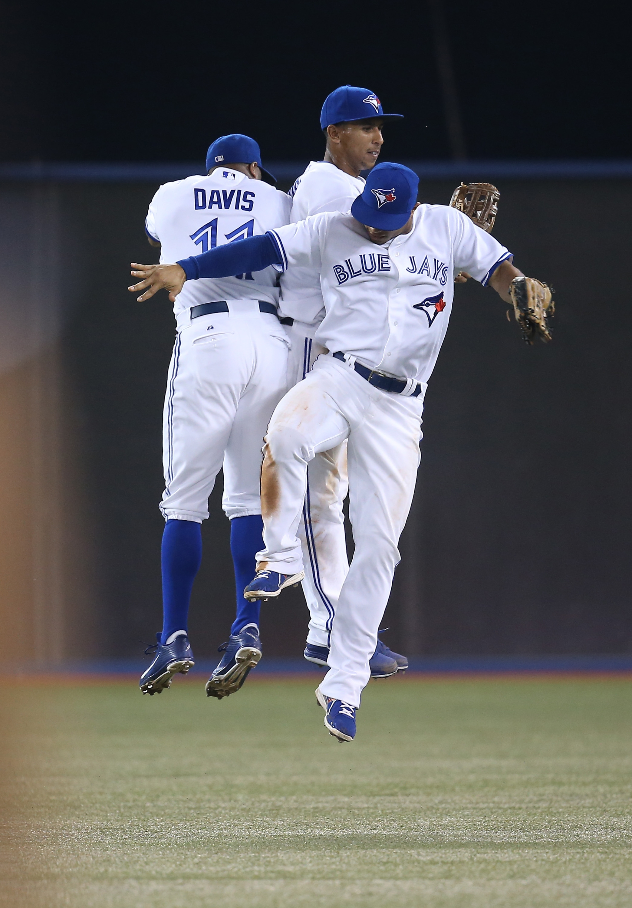 Blue Jays Rajai Davis, left, Anthony Gose, center, and Moises Sierra, foreground, celebrate their victory over the Yankees in Toronto on Wednesday.