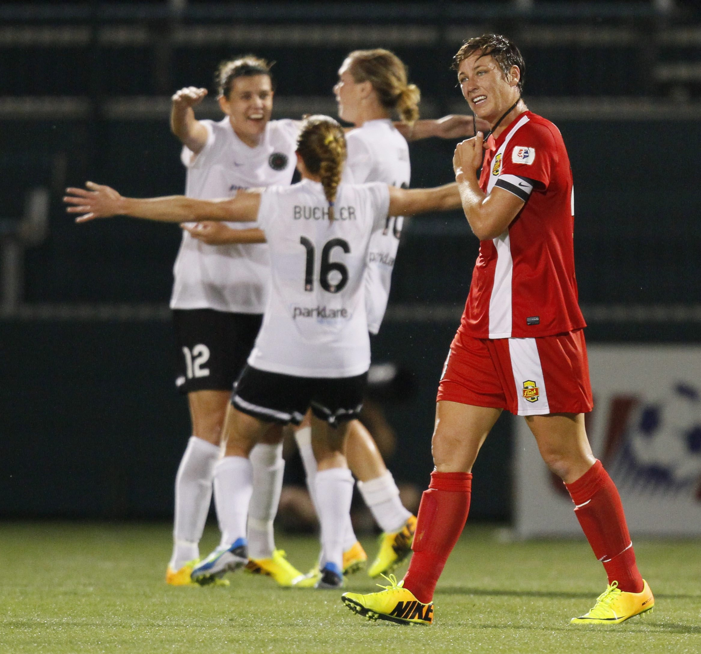 WNY Flash captain Abby Wambach walks off the field after the loss to the Portland Thorns in the NWSL Championship game.