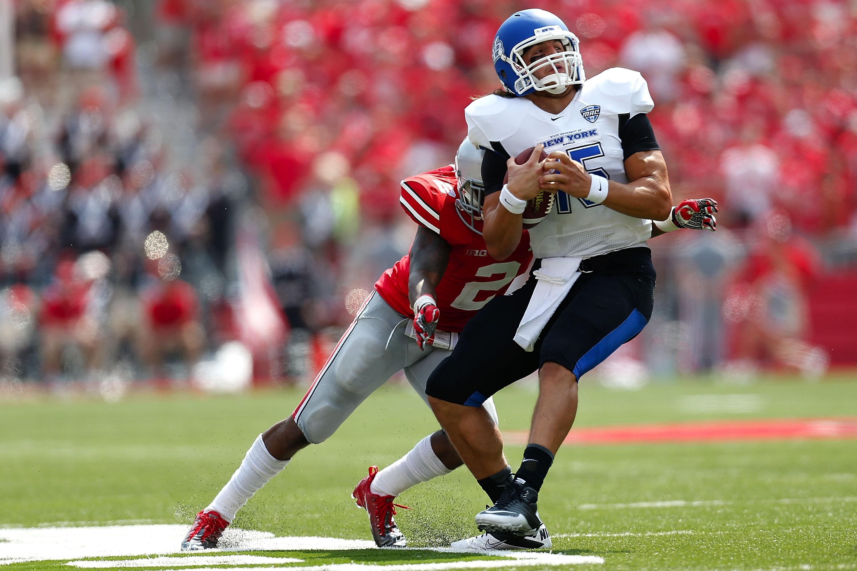 Ohio State's Christian Bryant tackles UB quarterback Alex Zordich, who took over for Joe Licata in the fourth quarter.