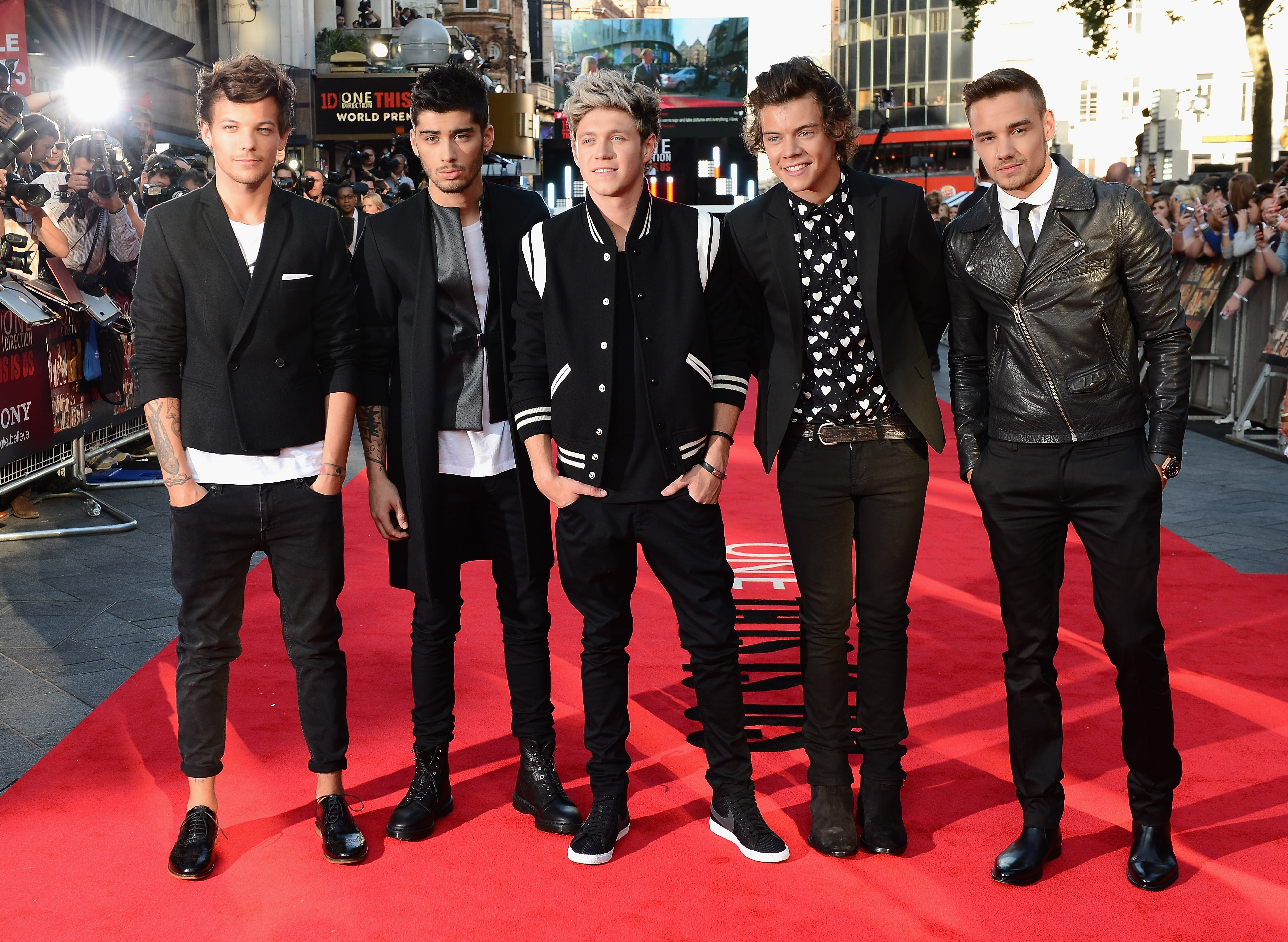 """From left, Louis Tomlinson, Zayn Malik, Niall Horan, Harry Styles and Liam Payne of One Direction attend the """"One Direction This Is Us"""" world premiere at the Empire Leicester Square this week in London."""