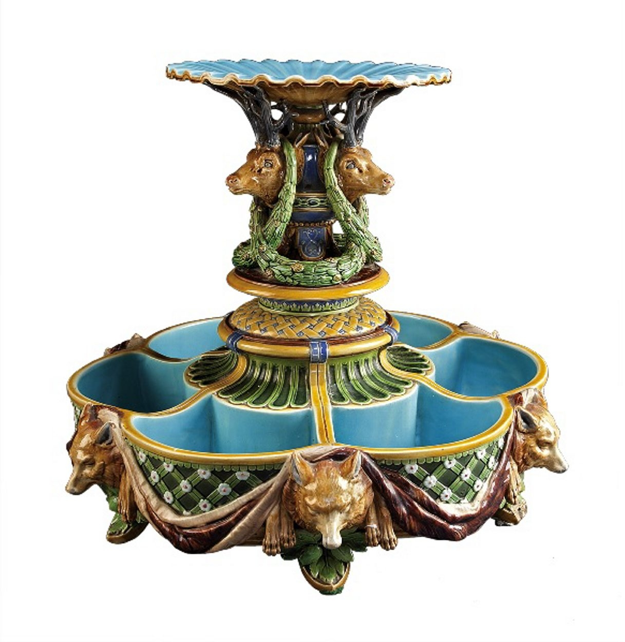 Why an ice stand would be decorated with stag heads and wolves is a mystery, but this 14-inch-high piece of majolica, used to serve dessert, sold for $8,610 at Neal Auction Co. in New Orleans.