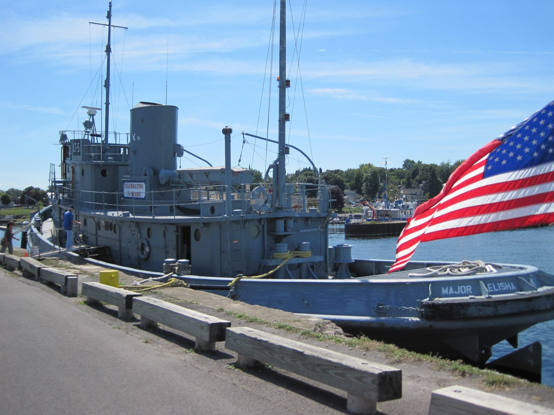 The Major Elisha K. Henson, a U.S. Army tugboat from World War II, is berthed alongside the White Museum in Oswego.