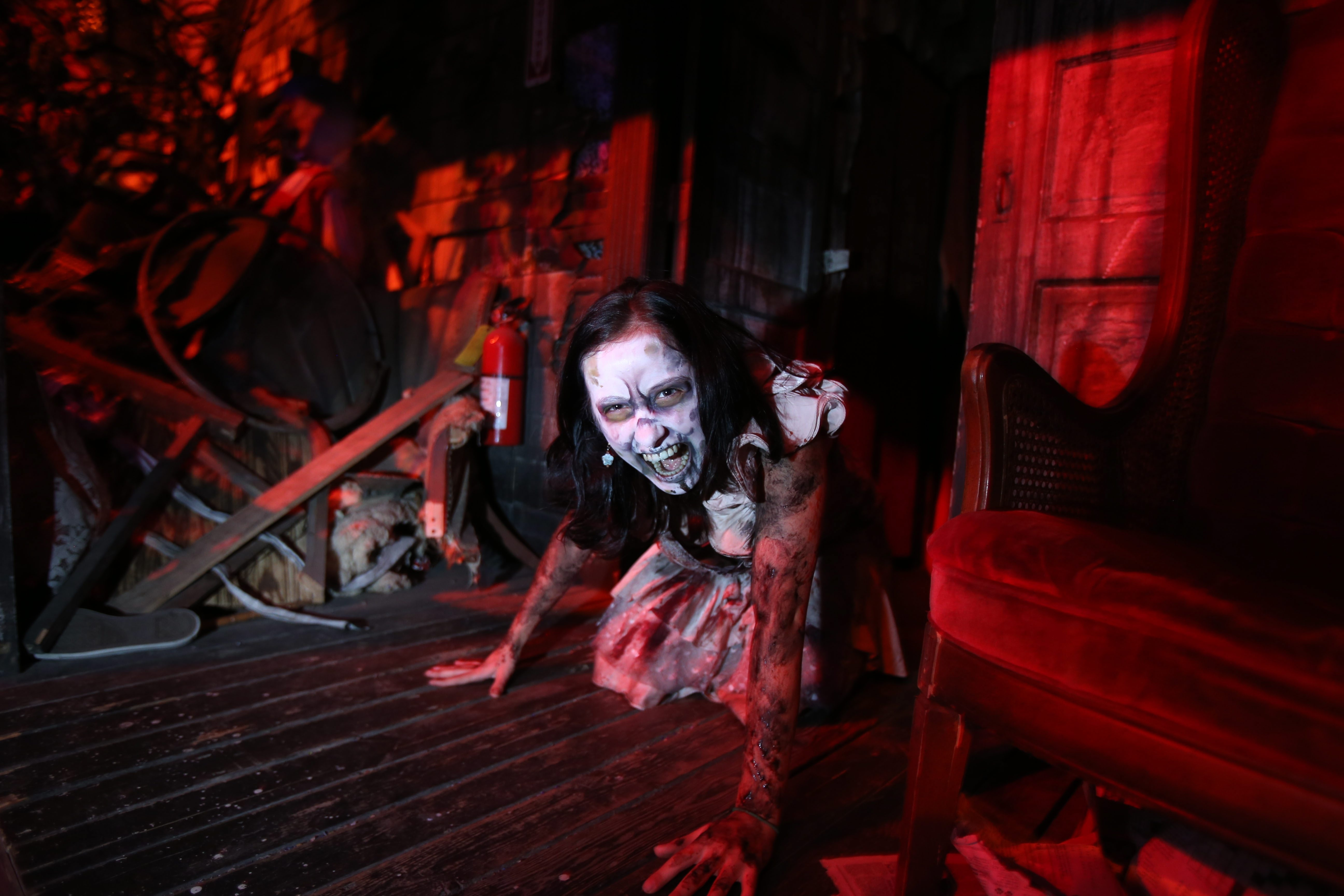 Cari Hurley, 17, gets in character for her job posing as a scary young girl named Dolly at Frightworld in Tonawanda.