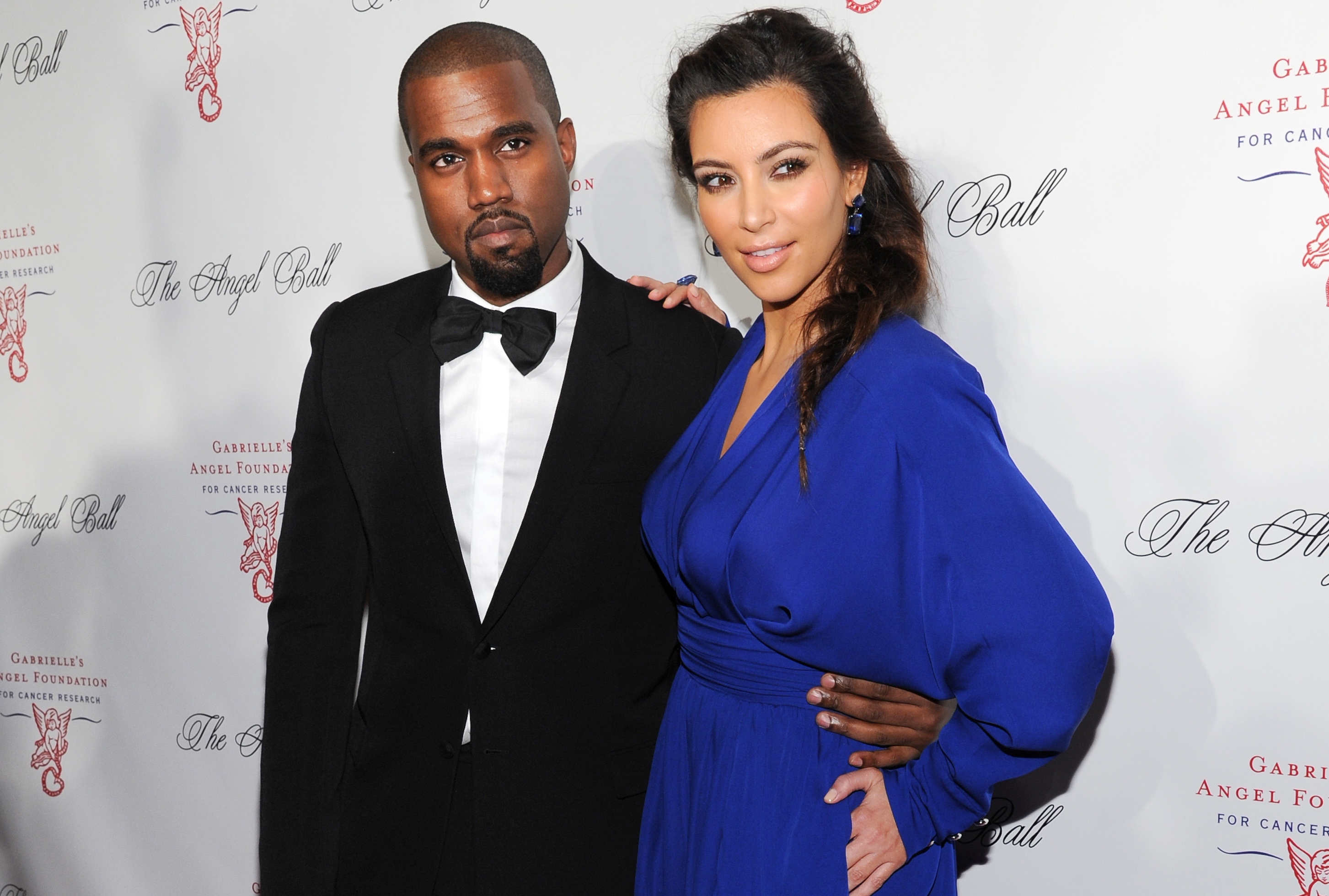 Singer Kanye West and girlfriend Kim Kardashian, shown at a 2012 event, will be tying the knot. West proposed Monday at AT&T Park in San Francisco.