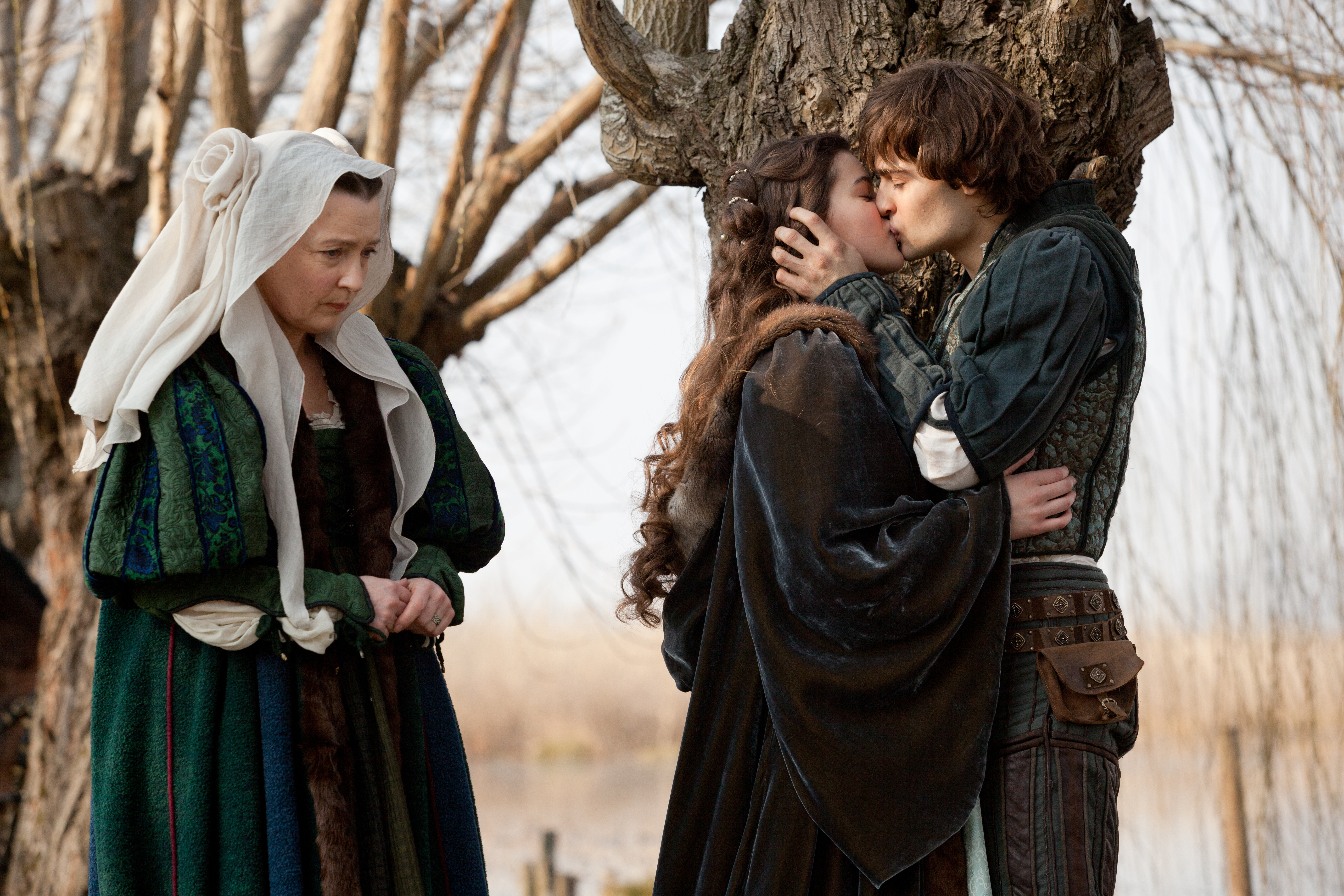 """This image released by Relativity Media shows Douglas Booth, right, and Hailee Steinfeld, center, in a scene from """"Romeo and Juliet."""" (AP Photo/Relativity Media, Philippe Antonello)"""