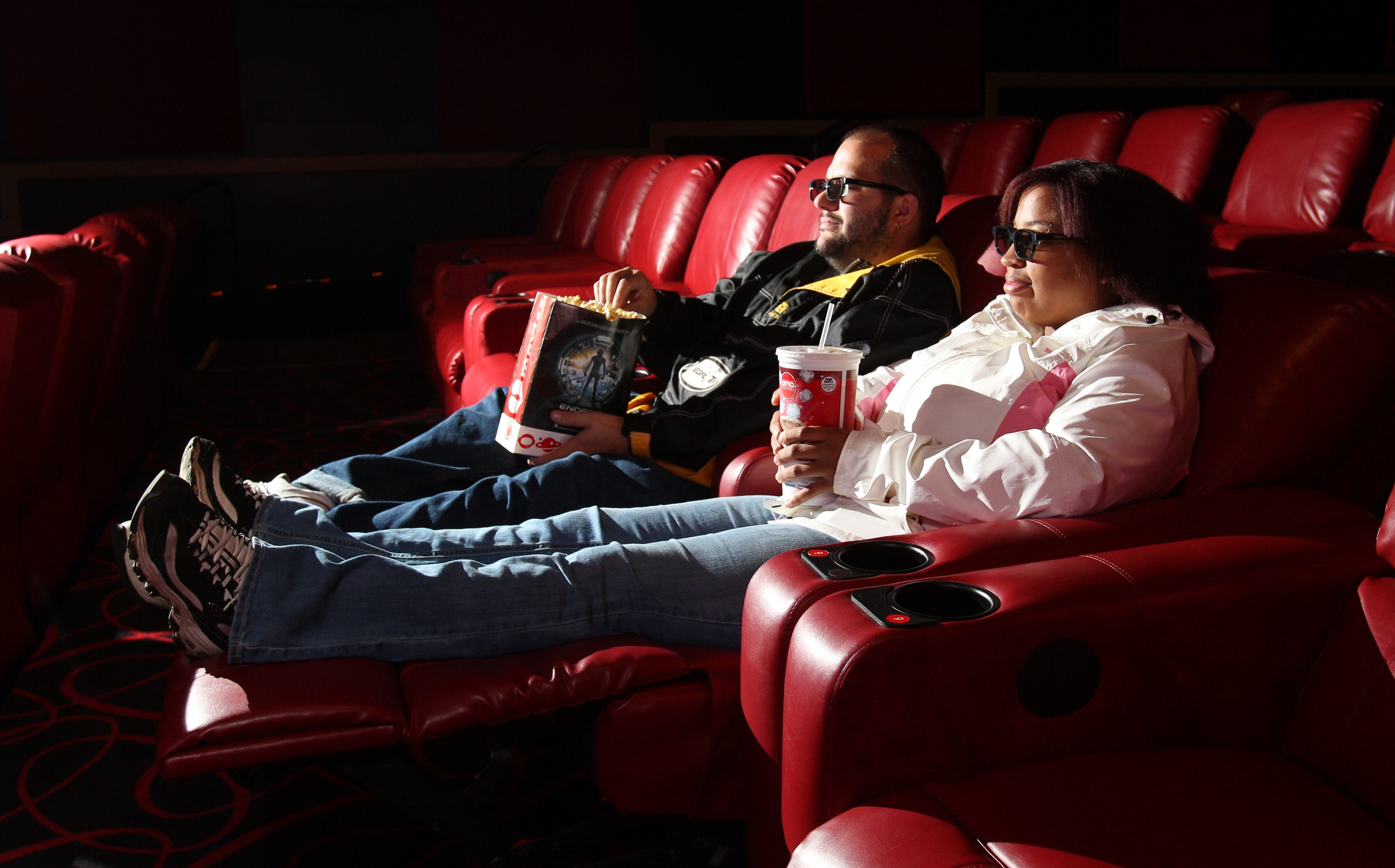 Howard Farrell and Angela Tyson of Buffalo sit in the new reclining seats at the AMC Maple Ridge 8.