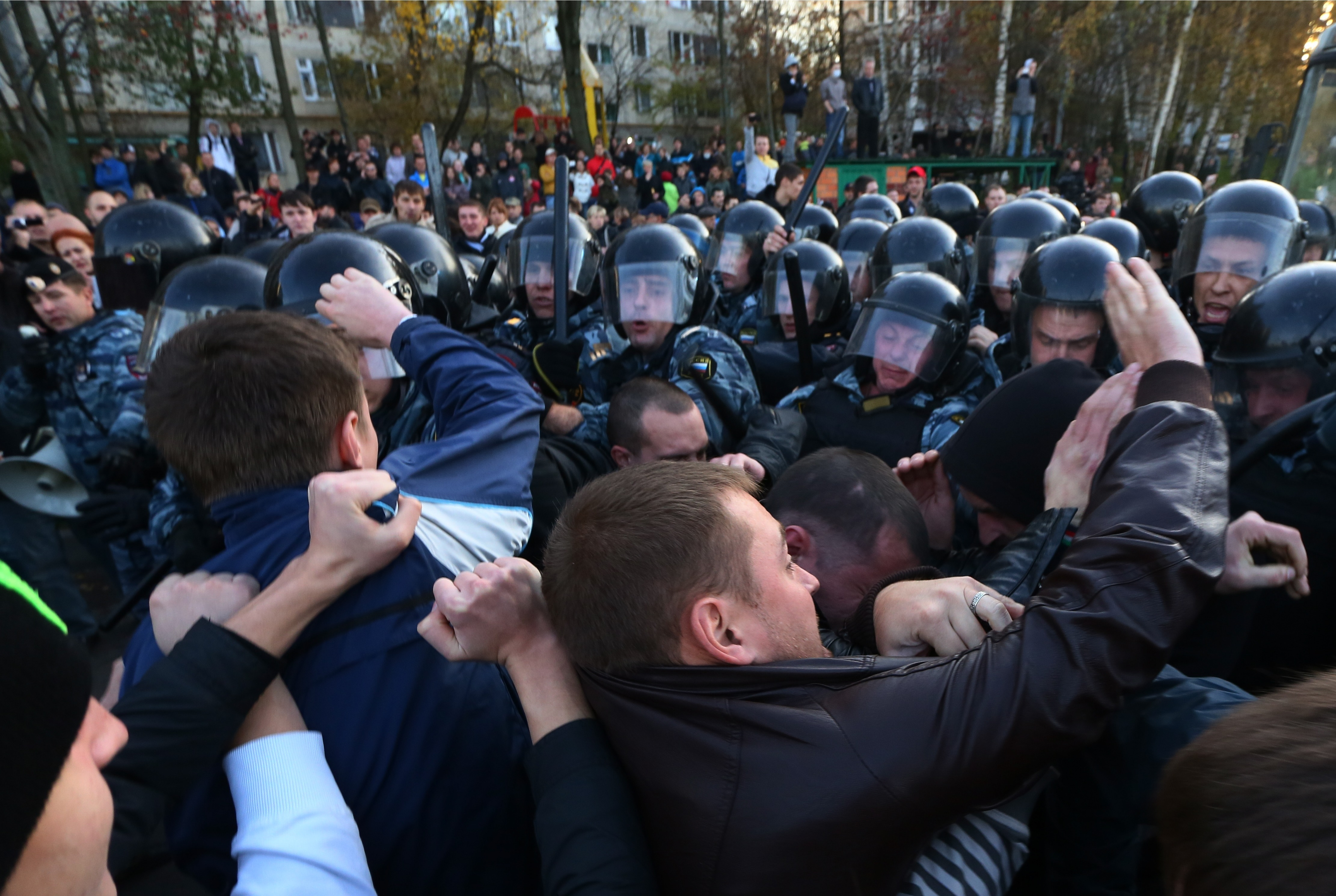 Protesters clash with police in Moscow suburb of Biryulyovo after last week's fatal stabbing of a 25-year-old local resident triggered demands for eviction of migrant workers. The more than 20 people wounded included six police officers.