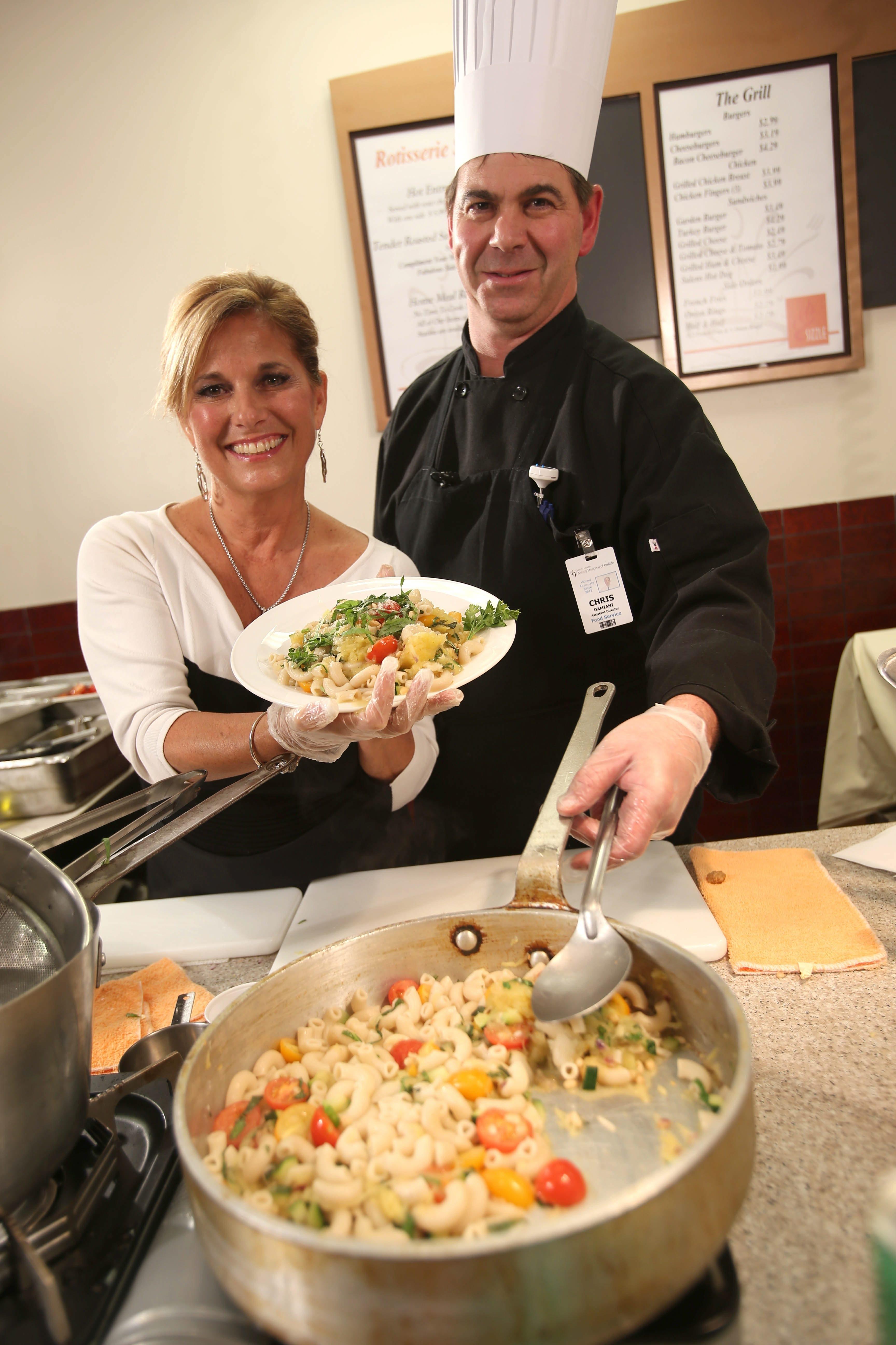 Nurse Karen Calandra, left, helps chef Chris Damiani cook spaghetti squash.