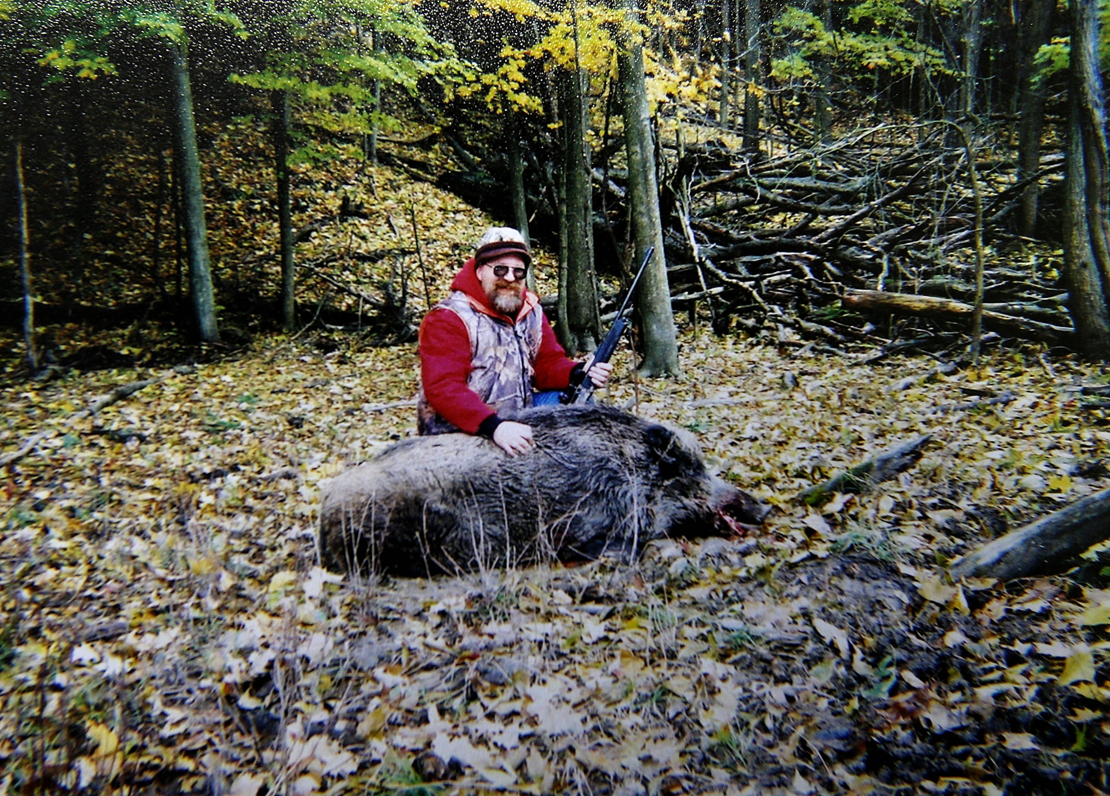 Hunter John Lord, a client of Pete Smith's Creekside Outdoors in Forestville, poses with a boar from a recent successful hunt at the hunting preserve.
