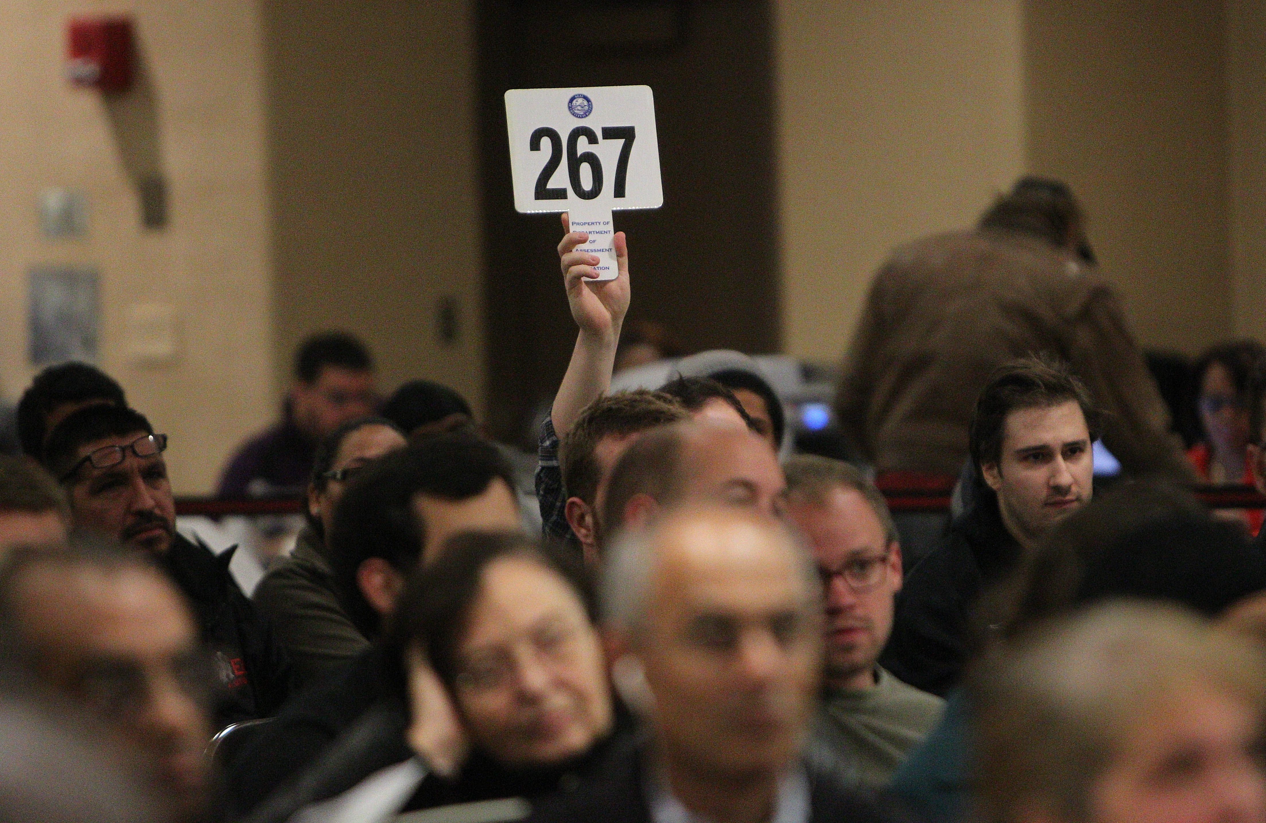 Bidder 267 is one of hundreds who turned out for the city's property auction.