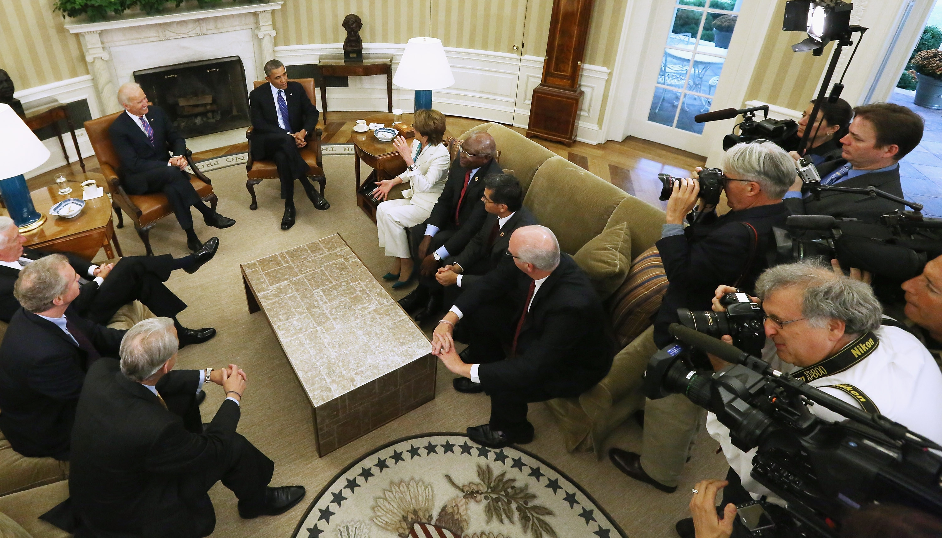 President Obama and Vice President Biden meets with House Democratic leaders in the Oval Office at the White House Tuesday as the debt limit looms and the partial shutdown of the government moves into its third week.