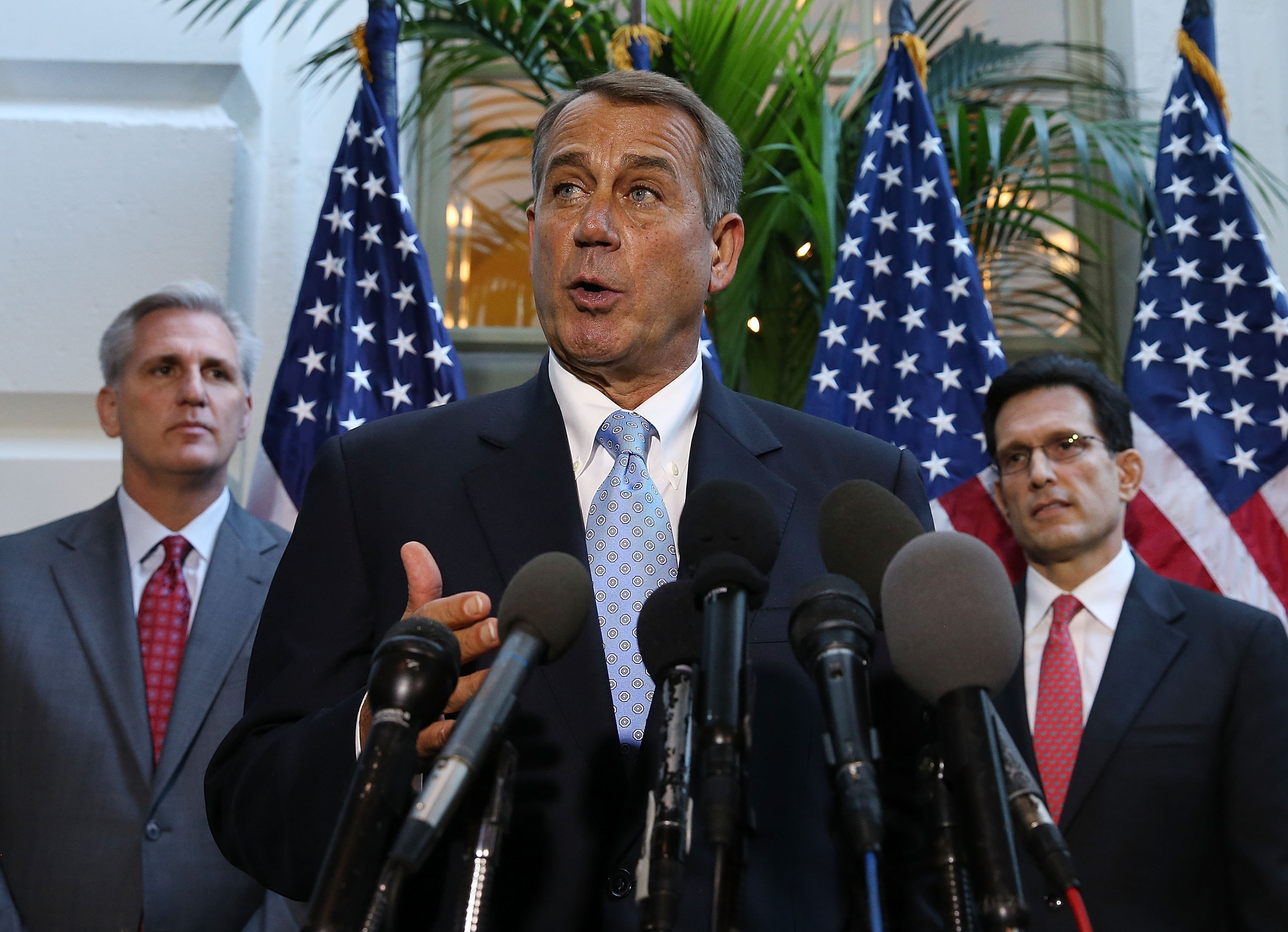 House Speaker John Boehner speaks to the media while flanked by House Majority Leader Eric Cantor after a party caucus Tuesday. The nation is less than 48 hours away from default.
