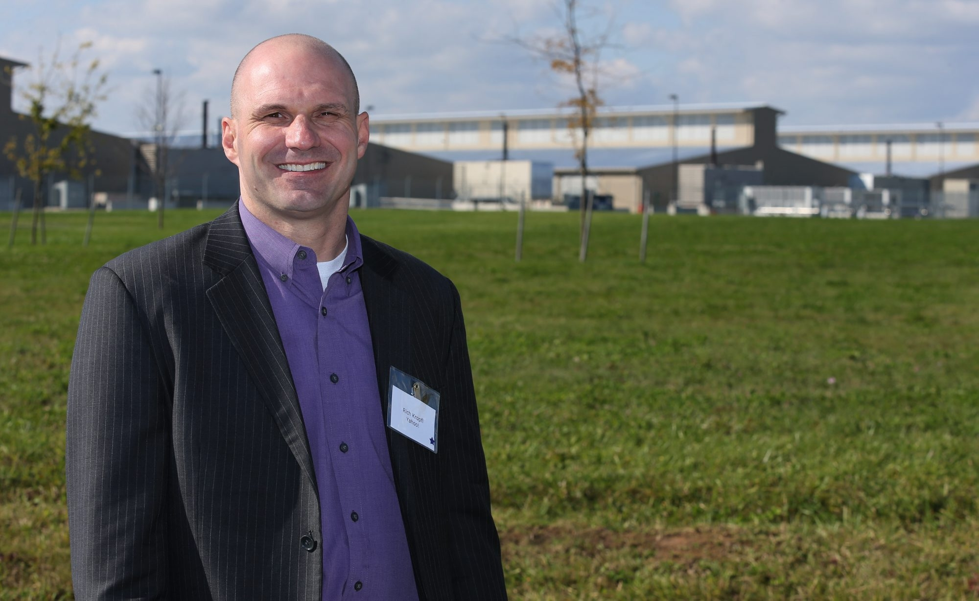"Rich Kropfl, Yahoo vice president for data center operations, stands in front of the ""chicken coop"" style center in Lockport, the company's most energy-efficient facility."