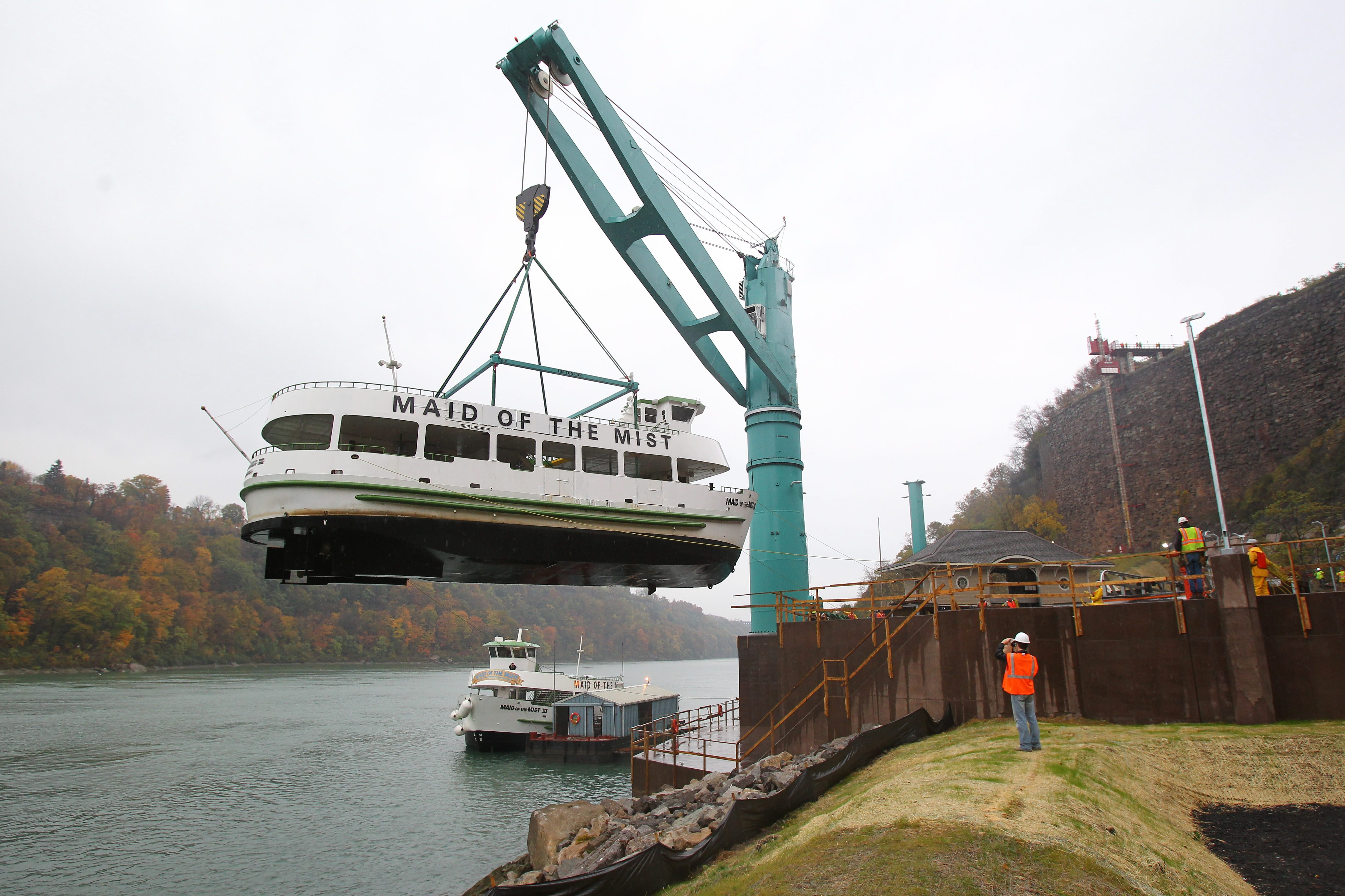 The electric-powered, 96-foot-high Liebherr Crane lifts the Maid of the Mist from the Niagara River and prepares to place it in its new dry dock at the former Schoellkopf Power Station site in Niagara Falls on Thursday.