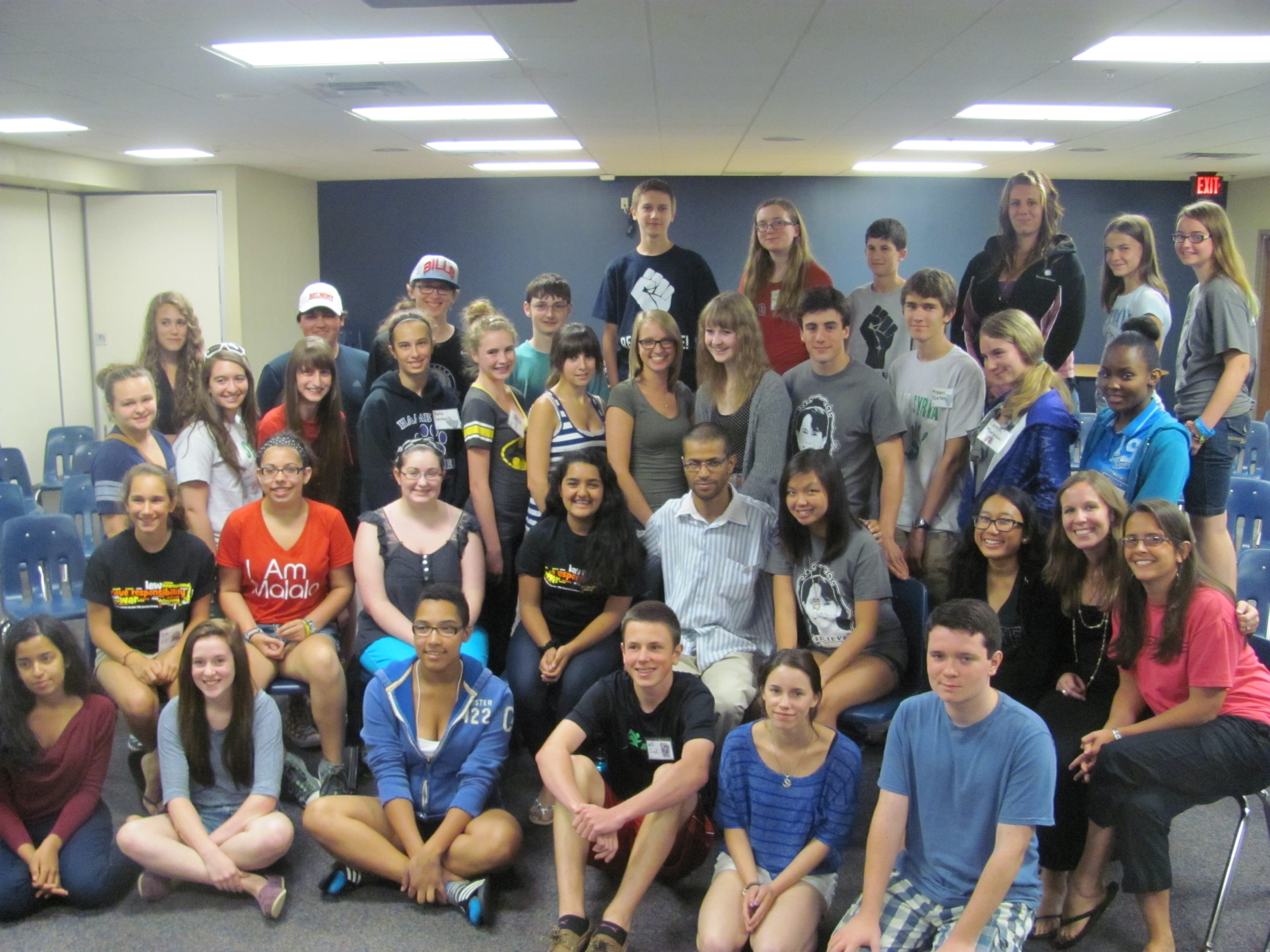 Human rights activist Jamel Bettaieb, center, visits with students who participated in the Summer Institute.