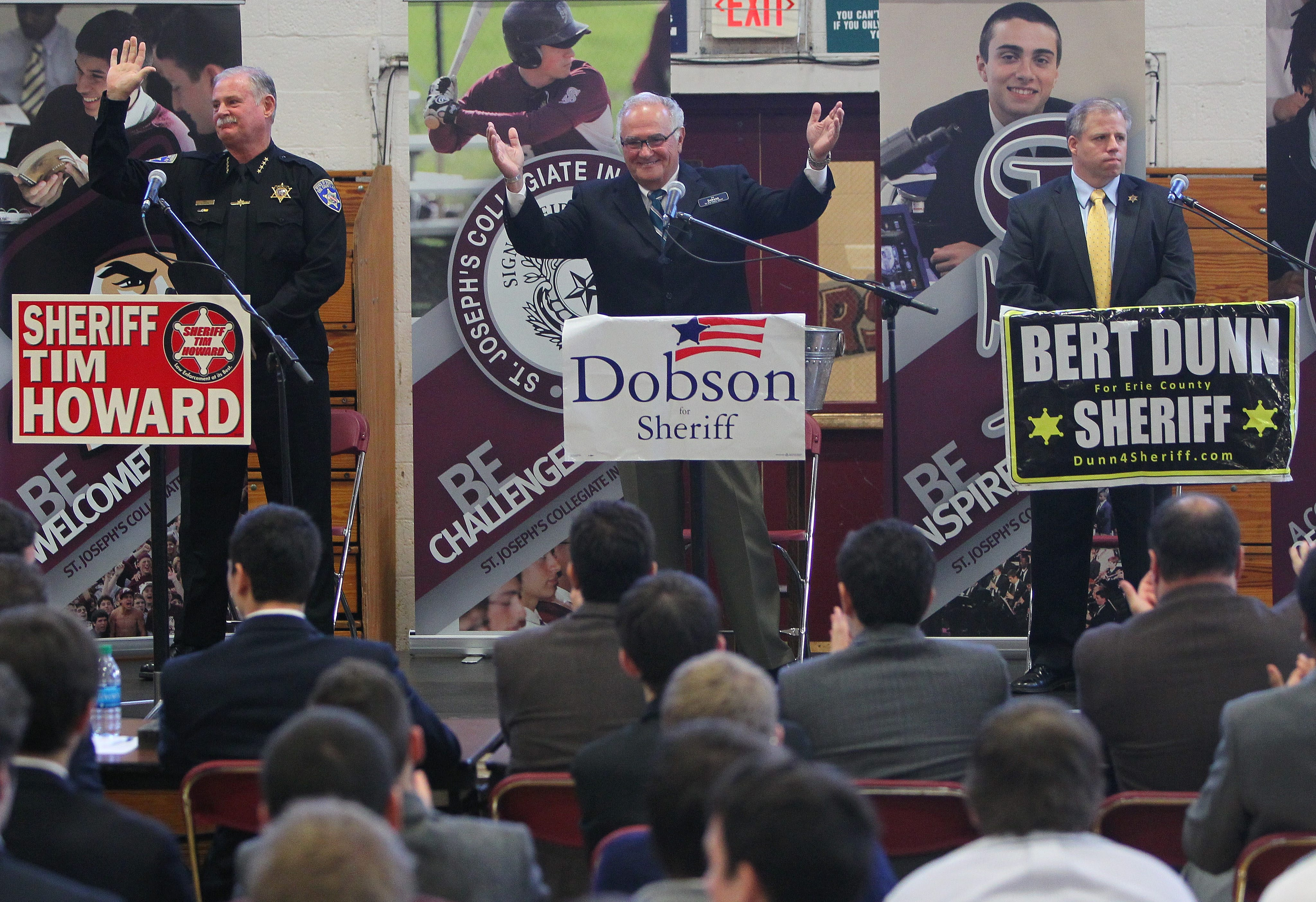Erie County Sheriff Timothy Howard, left, and challengers Richard Dobson, center, and Bert Dunn appear at a debate Tuesday at St. Joseph's Collegiate Institute.