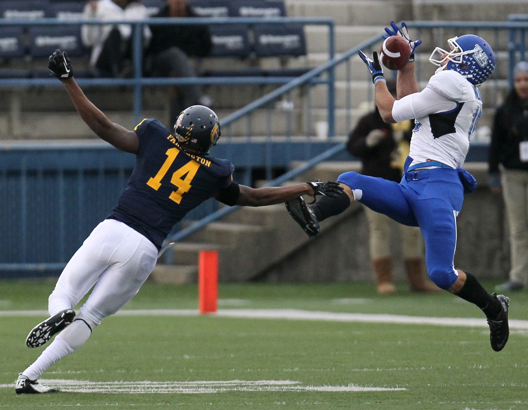 Kent State cornerback Dylan Farrington (14) can't stop Buffalo wide receiver Alex Neutz from catching a 49-yard pass.