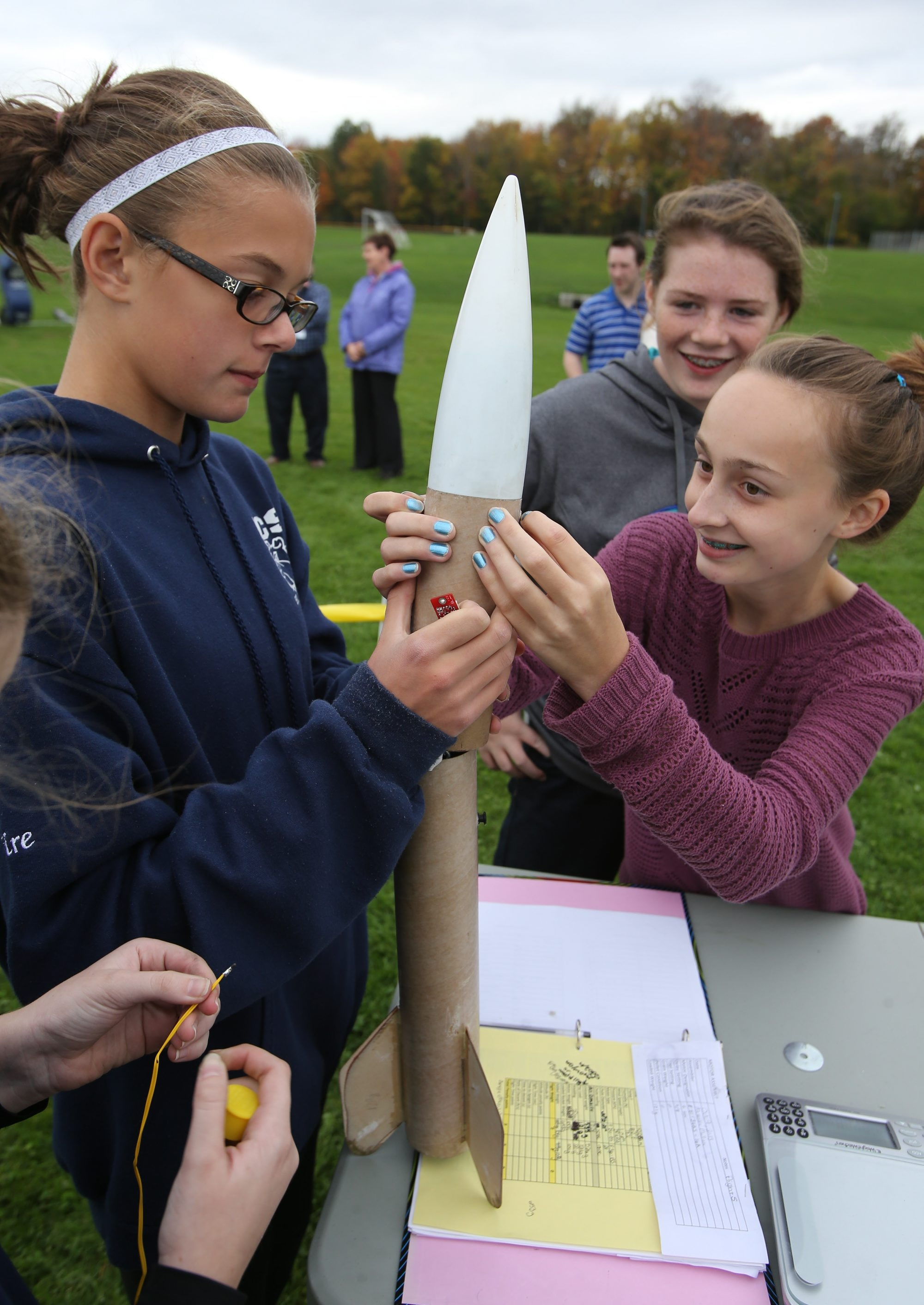 Claire Zwack,  left, and Grace Brach of Immaculate Conception School assemble a rocket during preparation for the Team America Rocketry Challenge on Sunday.