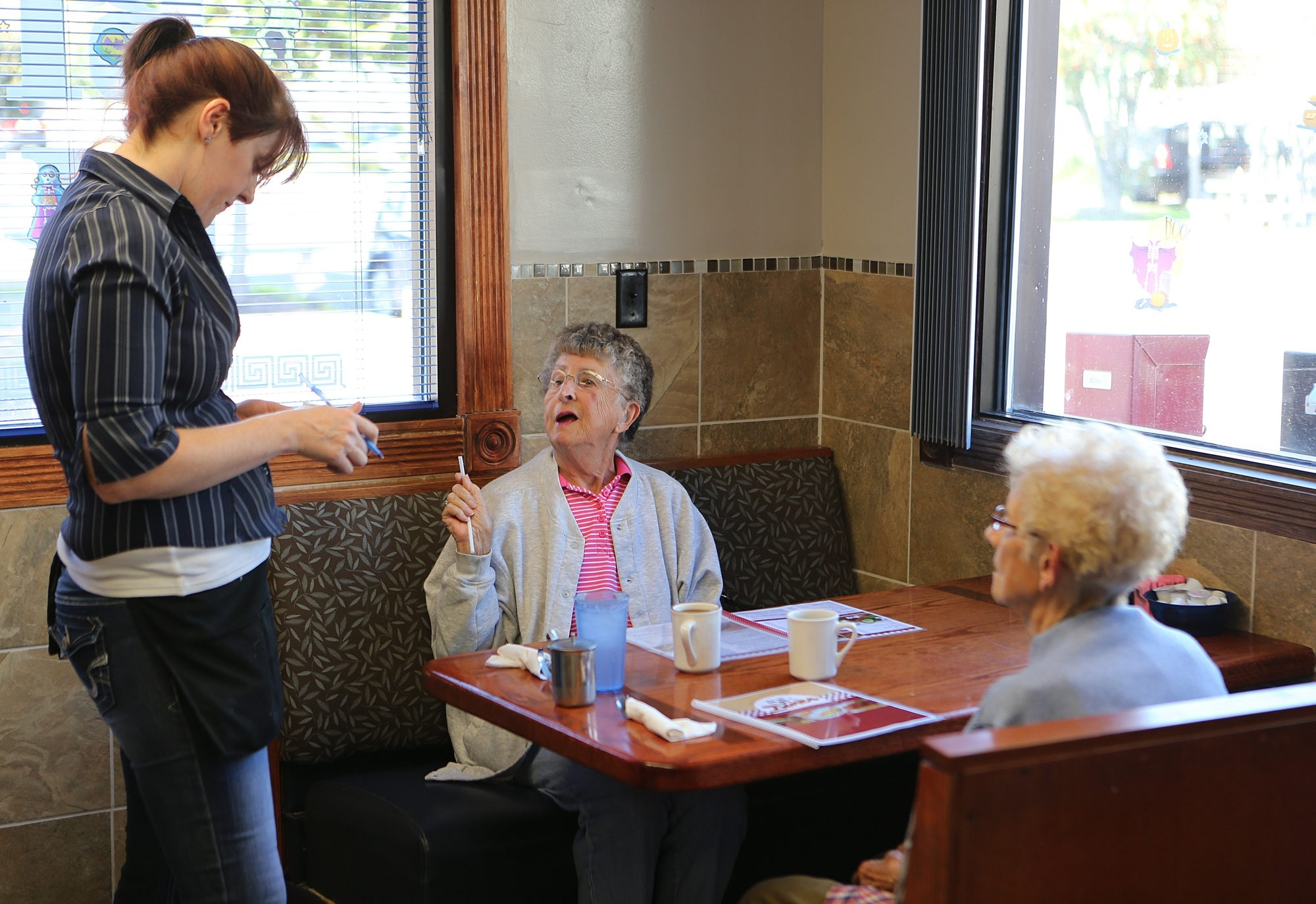 Stephanie Butler, left, takes an order from Linda Winkley, middle, and Dorothy Weir on Oct. 2 at Bill's Diner in Newfane.
