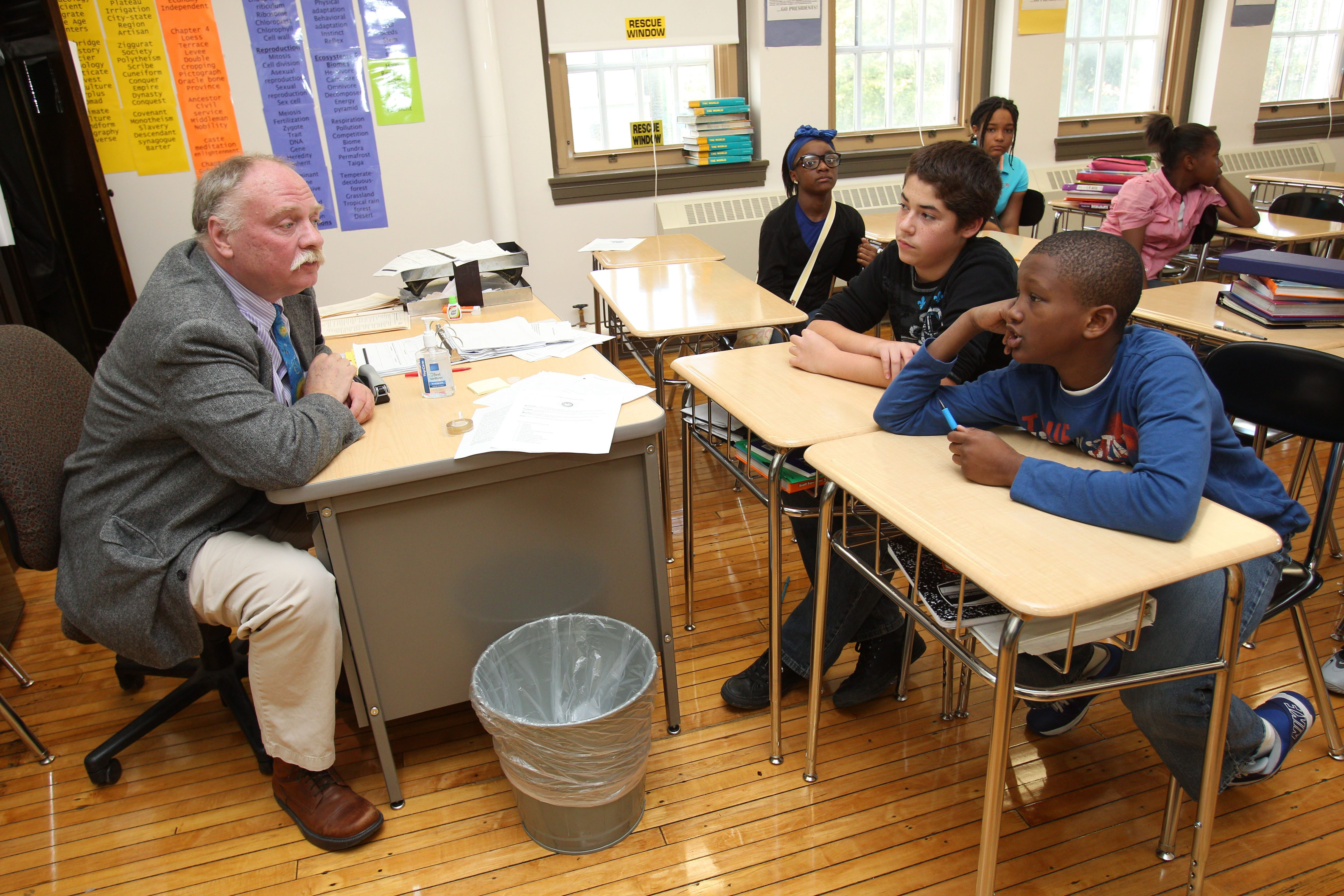 George Cleveland, the grandson of President Grover Cleveland, speaks to International Preparatory School sixth-graders Mashya Taylor, front row left, Michael Alvira, center, and Nolan Shephard.