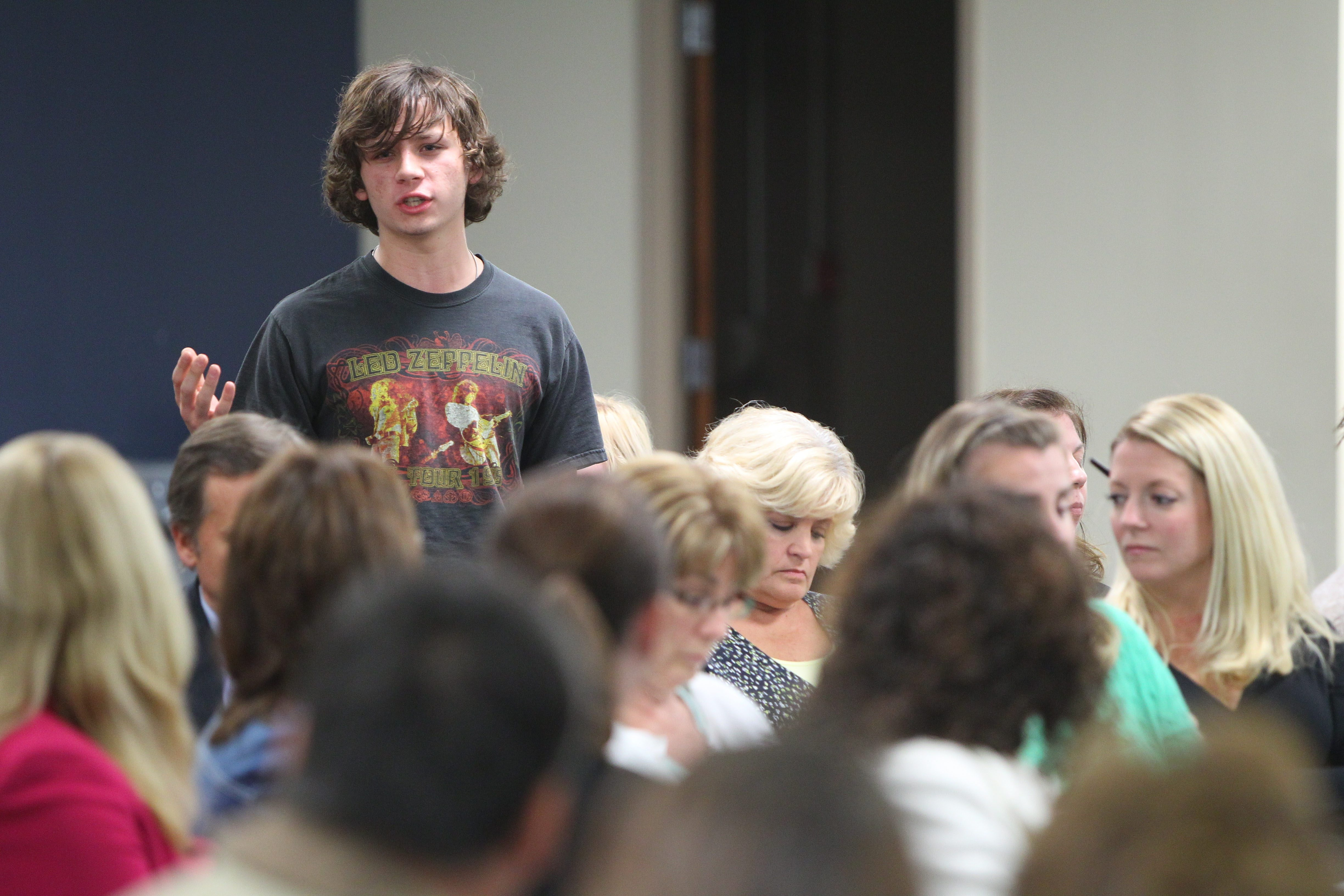 Gatlin Walters, a senior in the Hamburg Central Schools District, speaks with residents during a meeting about their schools at BOCES in West Seneca on Thursday.