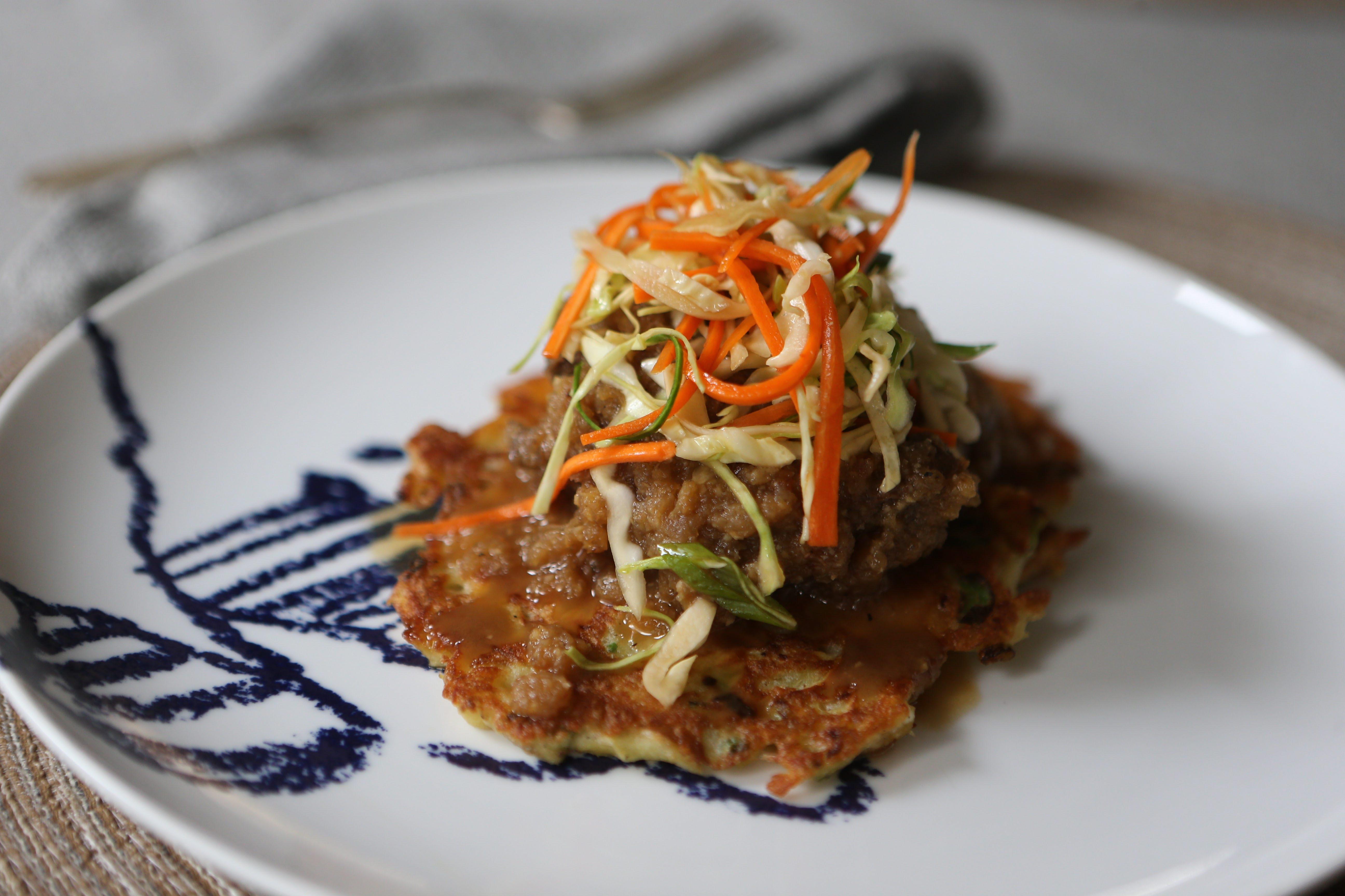 Apple-ginger braised short ribs on potato pancakes is a Polish-Korean hybrid.
