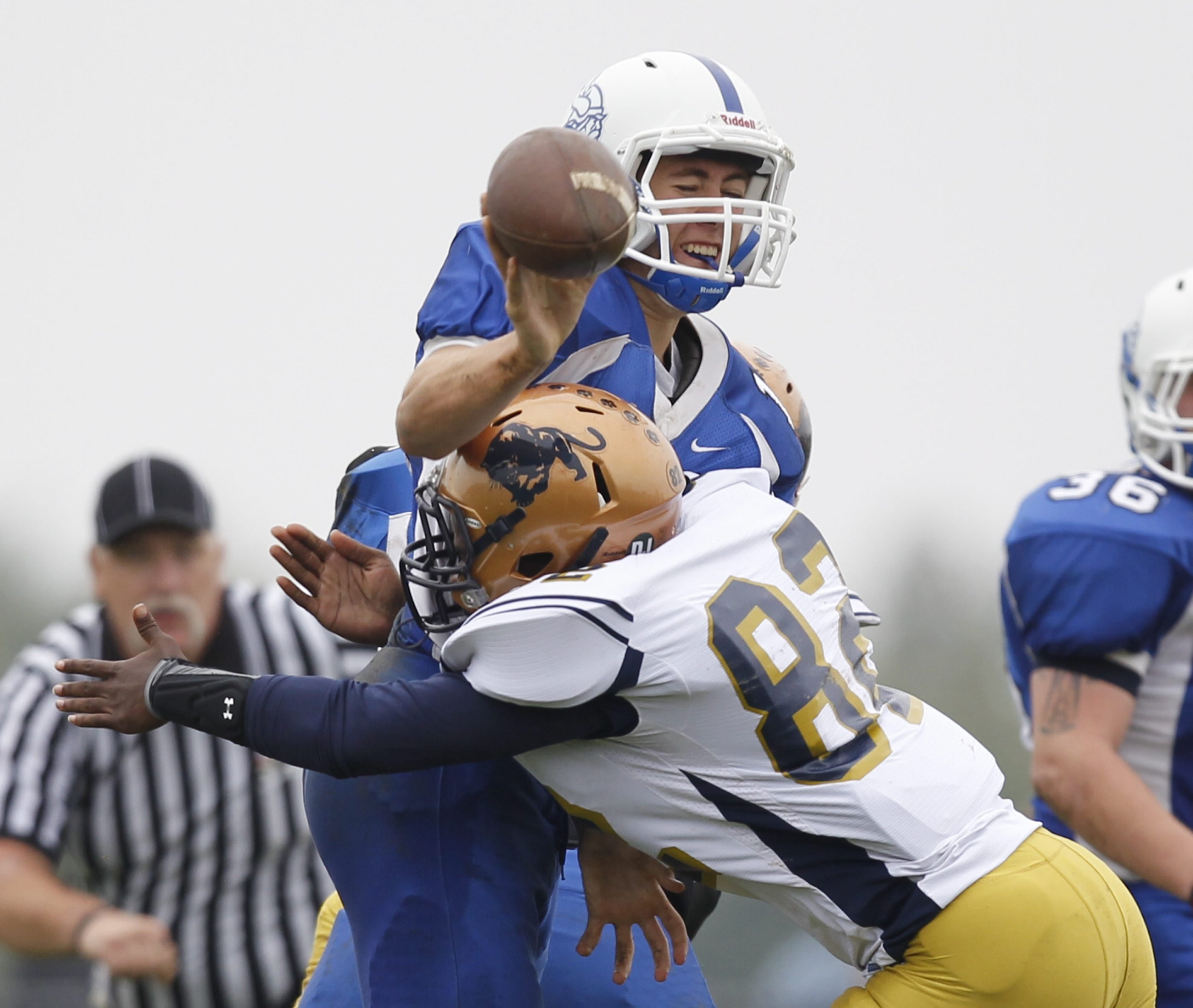 Sweet Home junior Rashad Woods disrupts the passing attempt of Grand Island senior quarterback Quinn Corrao during the first half of the Panthers' win.