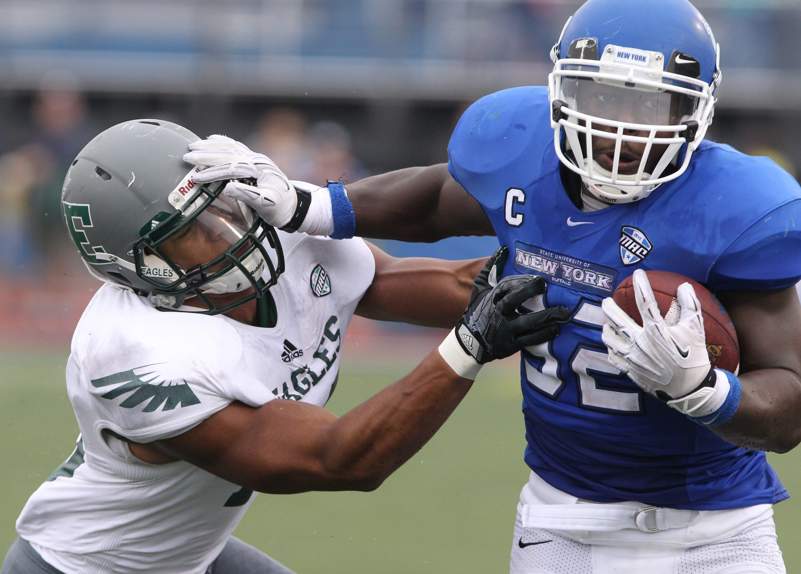 UB's Branden Oliver scores a touchdown over Eastern Michigan linebacker Ike Spearman in the third quarter.