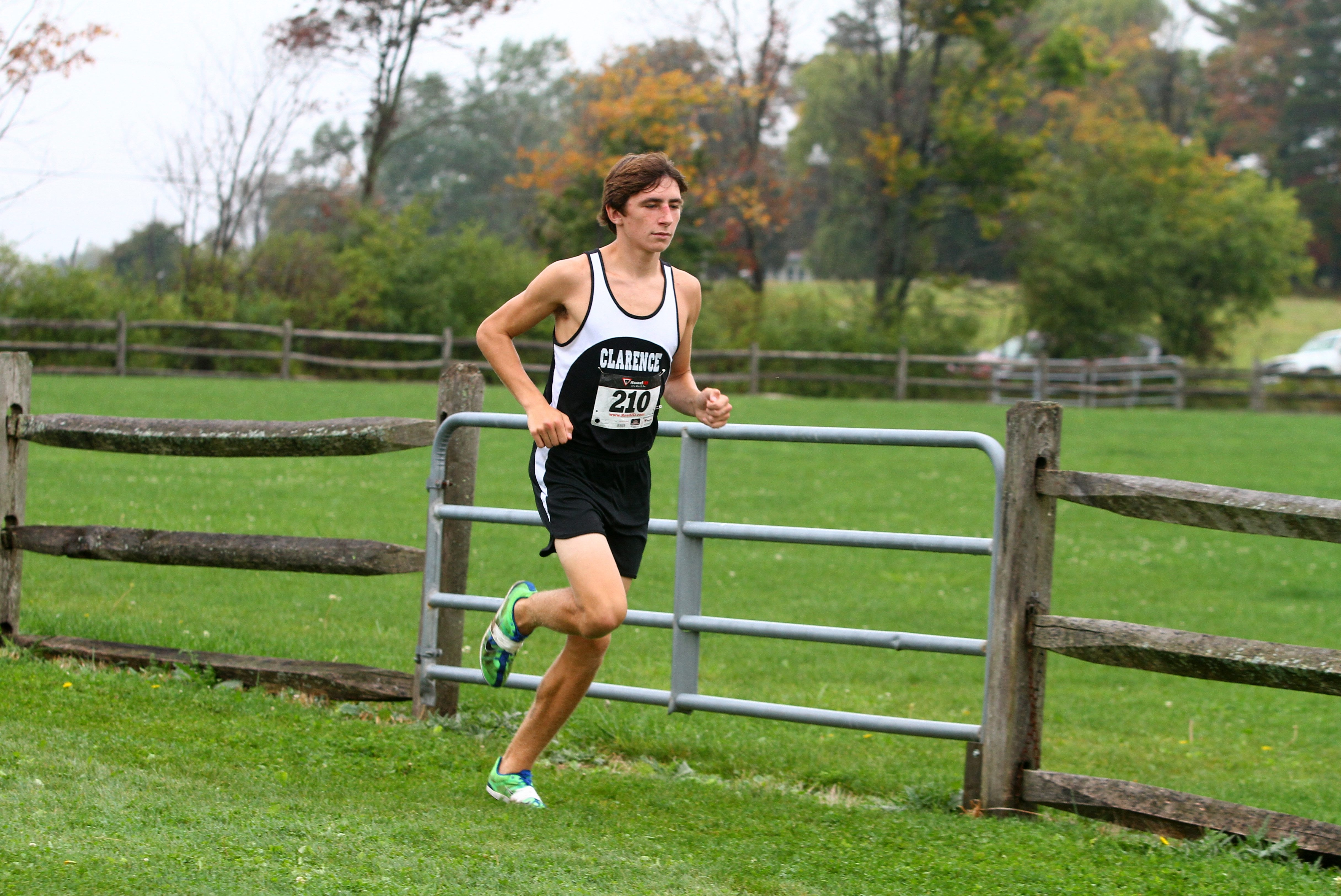 Dan Huben of Clarence won the varsity race at Knox Farms covering 3.1 miles in 15:56.28. The Red Devils had three in the top 10 to also take the team title.