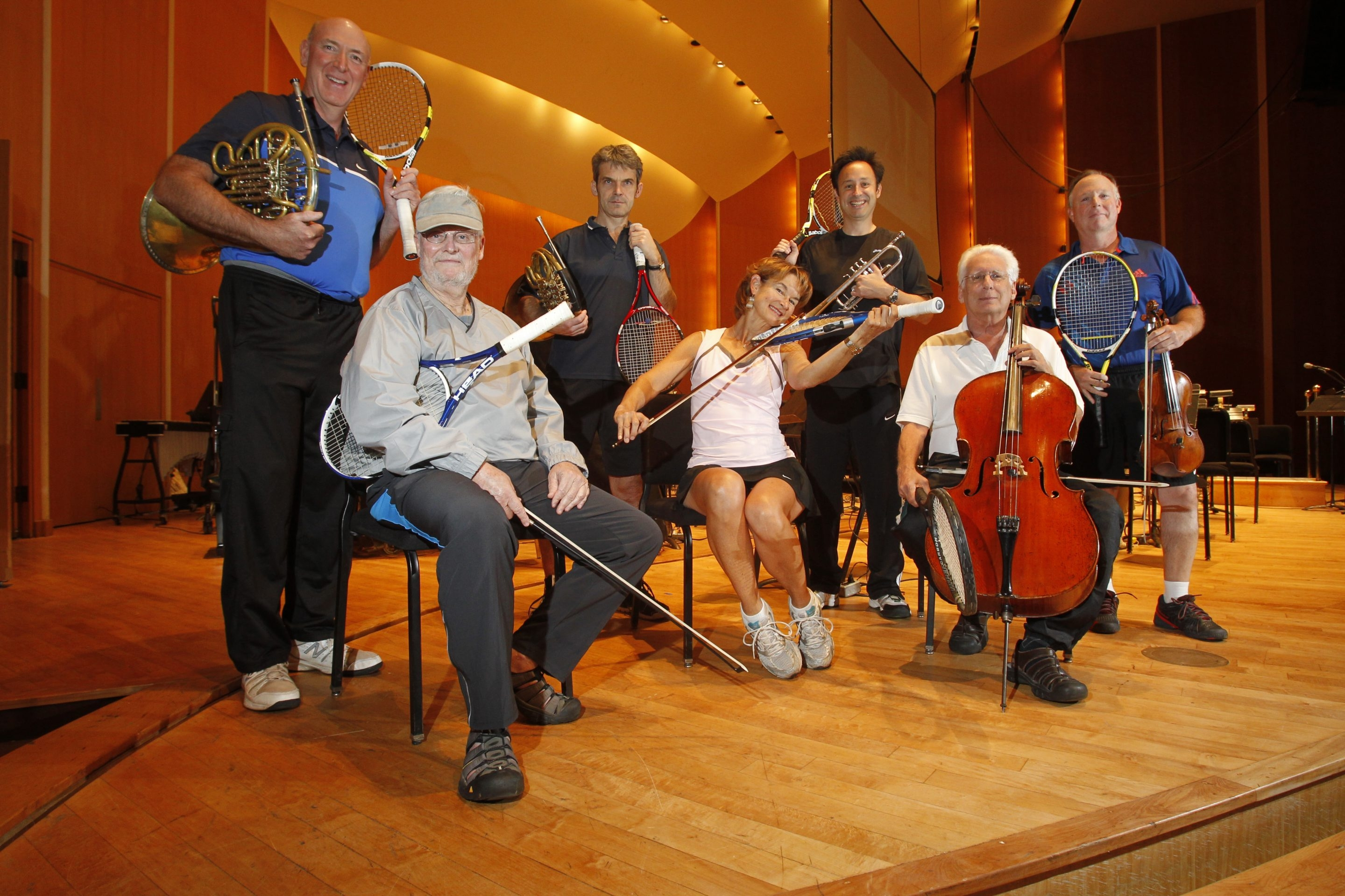 Buffalo Philharmonic Orchestra members, (sitting) Jeff Jones, Diana Sachs, Monte Hoffman, (standing L-R) Jay Matthews, Jacek Muzyk, Alan Ross and Geoff Hardcastle pose with their instruments and tennis rackets. Not pictured: Phil Christner, Roman Mekinulov.