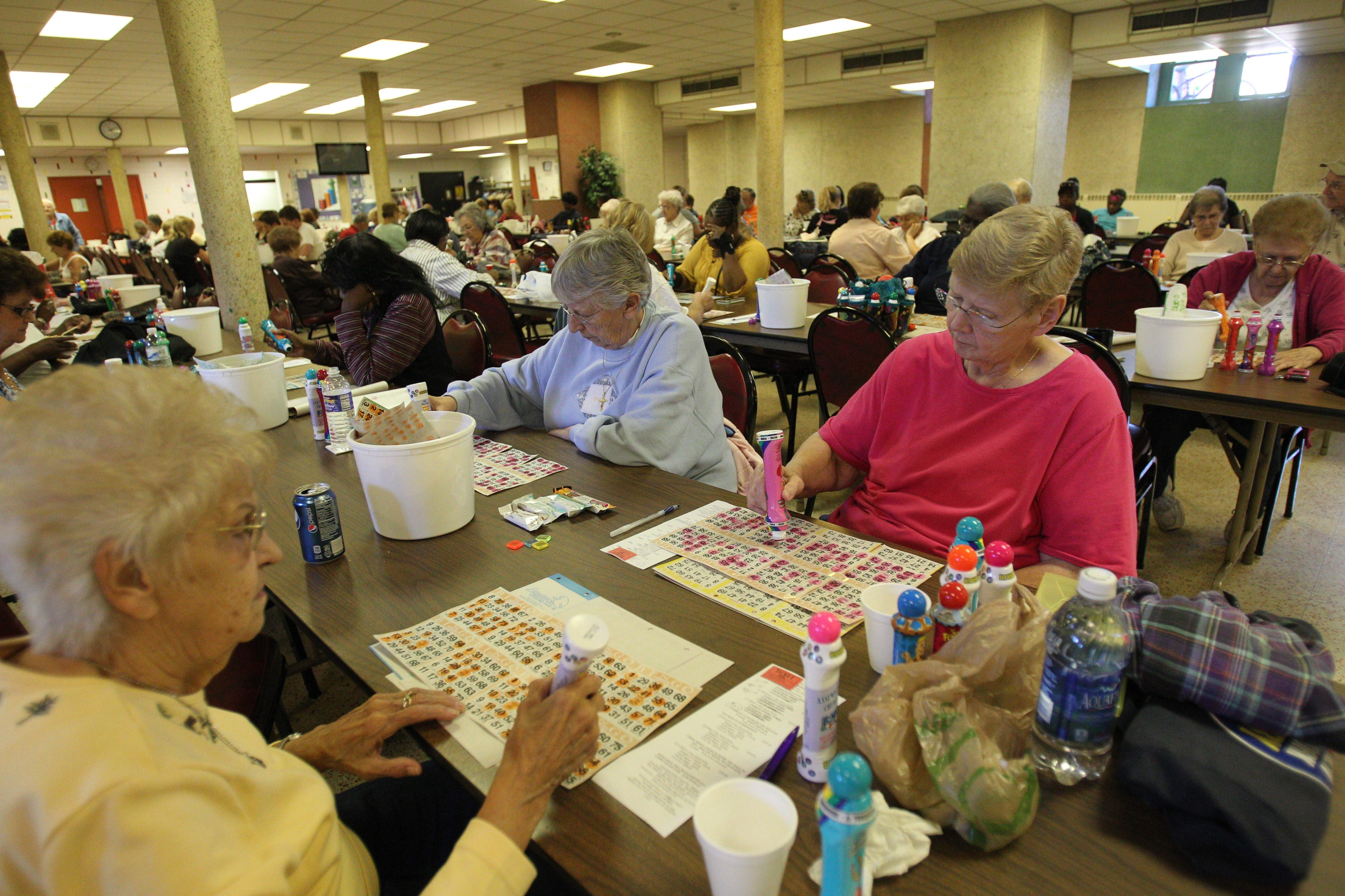 From left, Dorothy Wikierski, Jean Kusmierz and Ann Oxley enjoy playing bingo on Tuesdays at Assumption Church in Black Rock.