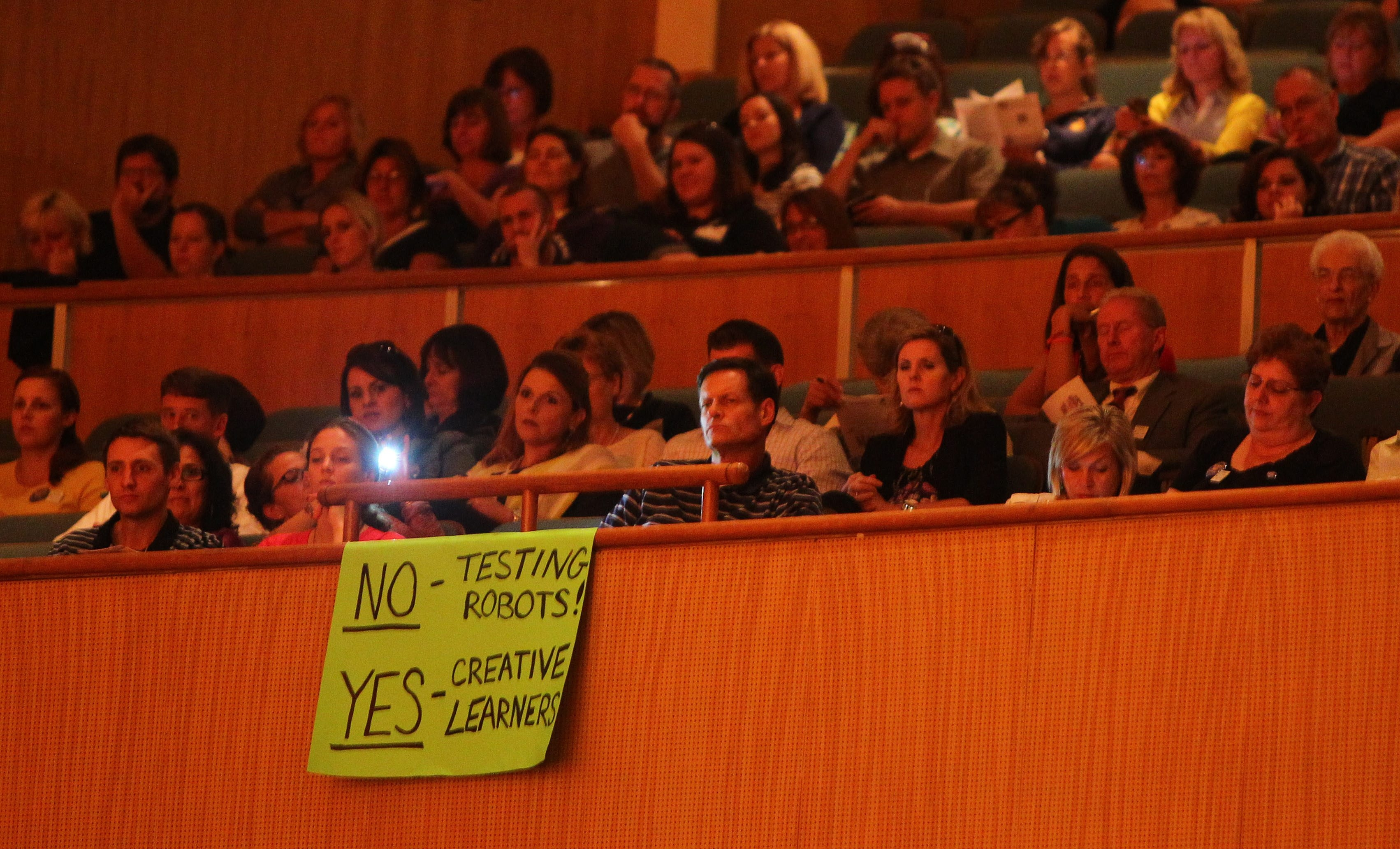 Parents and teachers listen to a speaker during the Summit for Smarter Schools in Kleinhans Music Hall on Wednesday.