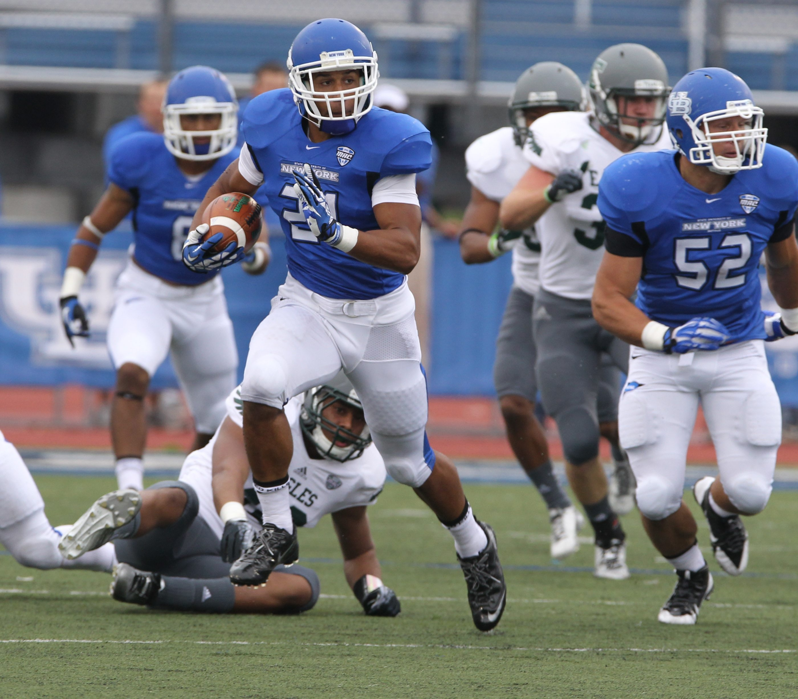 UB running back Devin Campbell is off on a 96-yard touchdown return of a kickoff in the Bulls' win over Eastern Michigan.