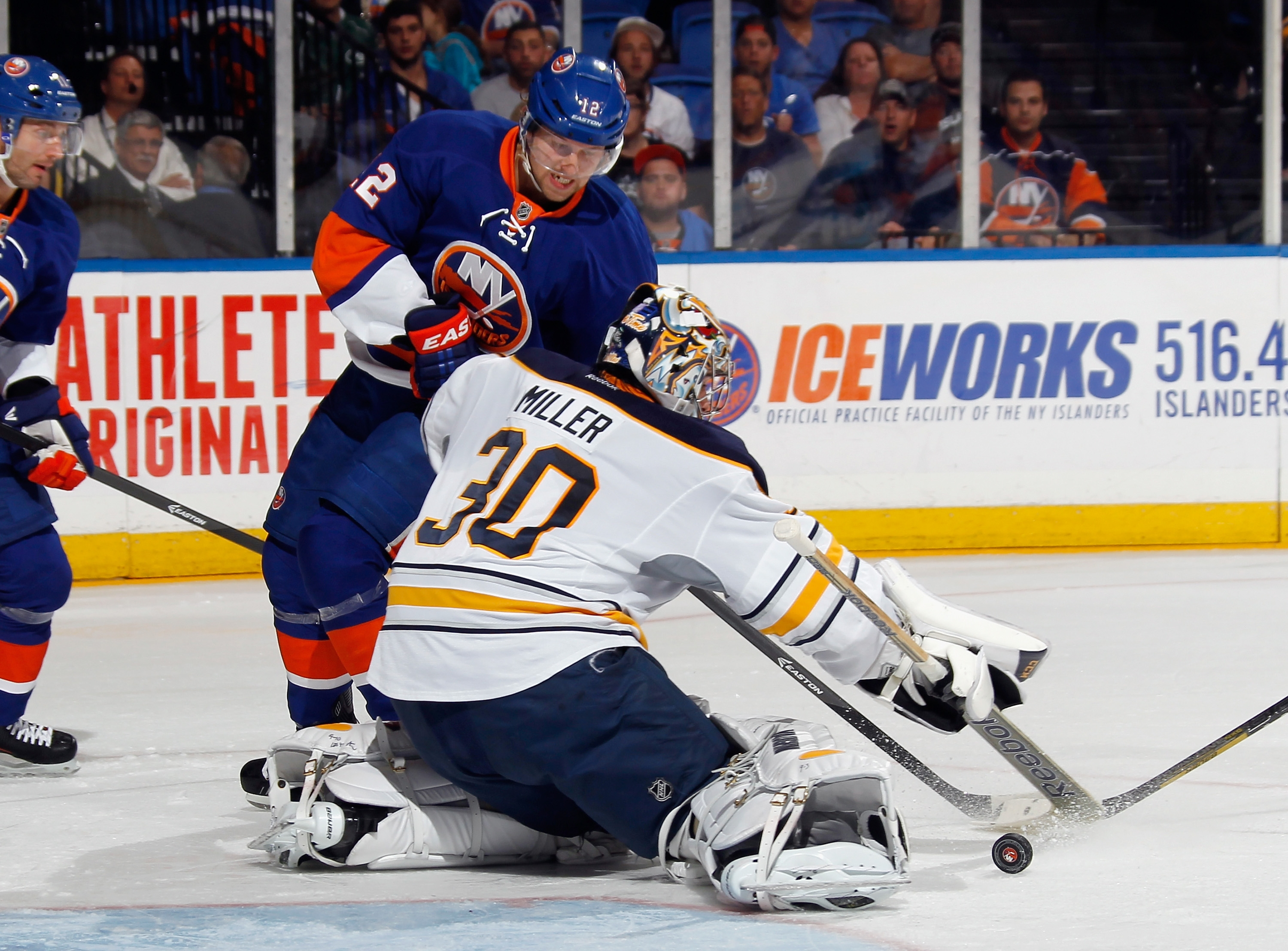 Sabres' goalie Ryan Miller stops a shot by Josh Bailey of the Islanders during Tuesday night's game in Uniondale.