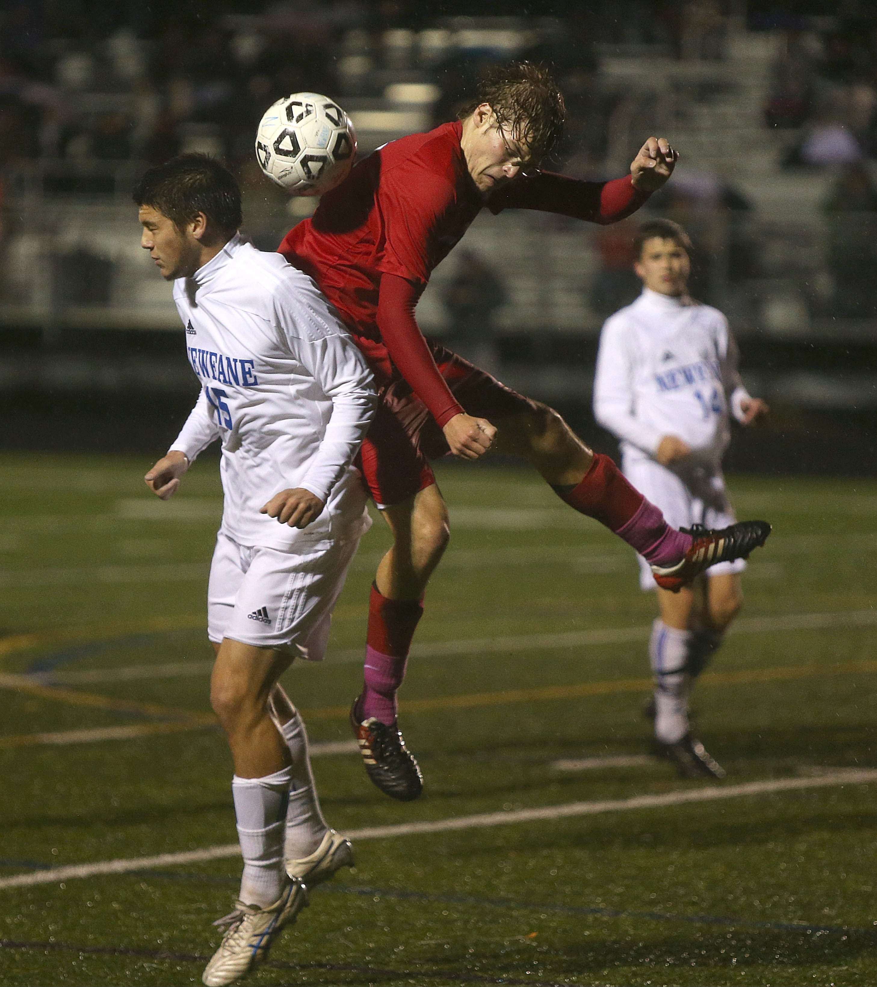 Medina's Hayden Allis, right, and Newfane's Chad Gibson go for the ball in Medina's 2-1 victory in double OT in Class B-1.