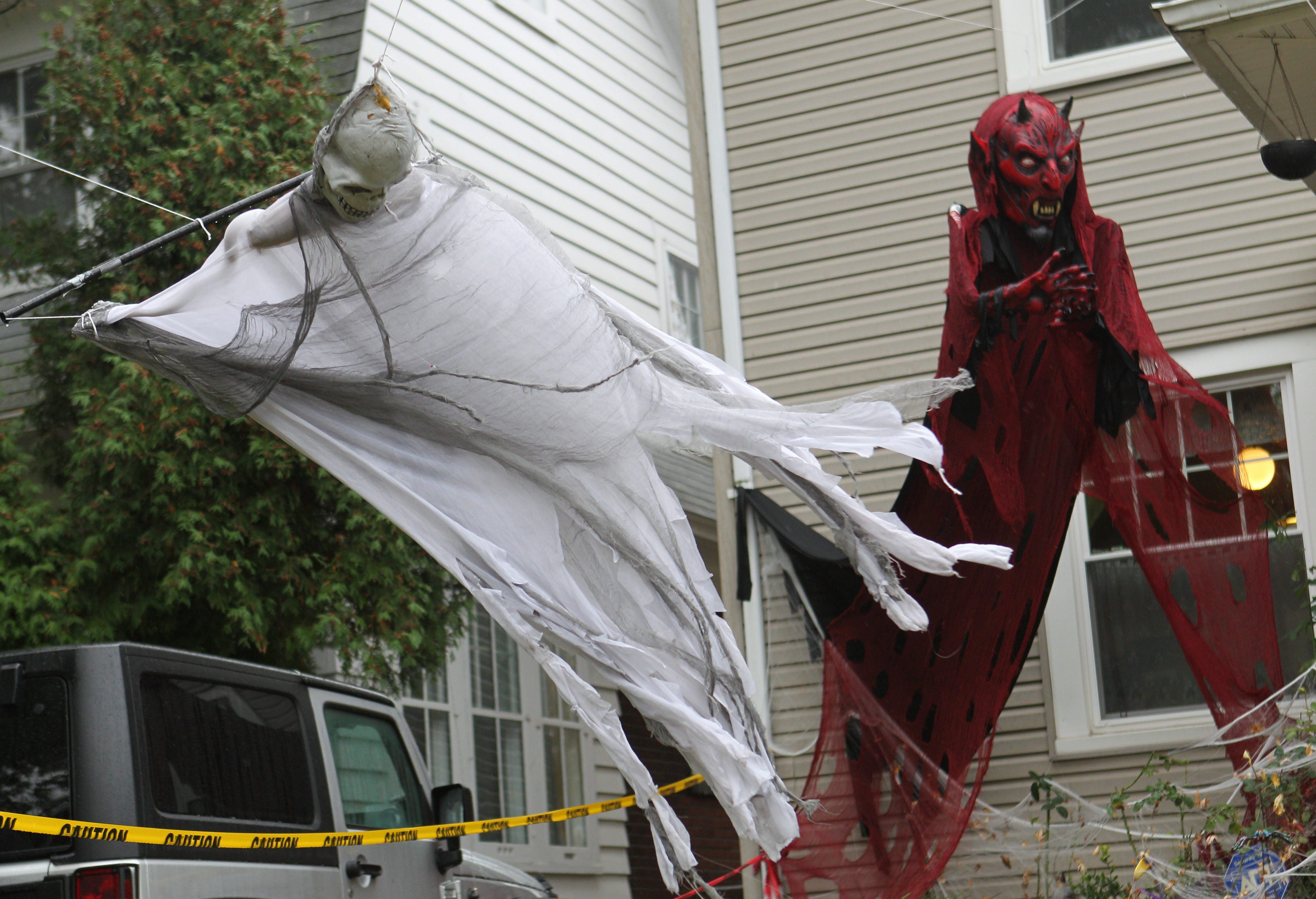 This ghost in decorated front yard on Admiral Road in Buffalo takes flight as the winds begin to pick up today. (Sharon Cantillon/Buffalo News)
