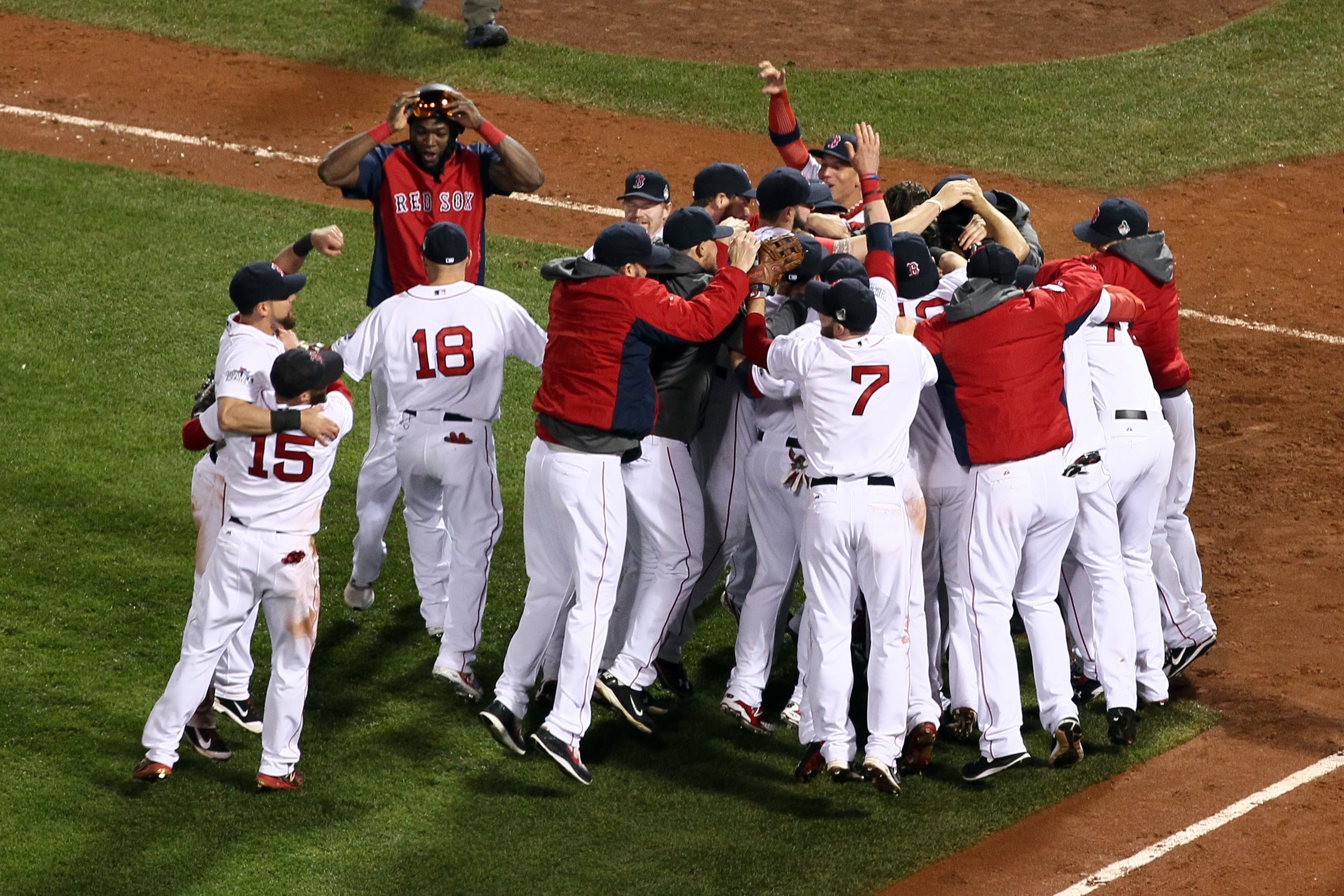 The Red Sox celebrate the first World Series title won in Boston since 1918 after defeating the St. Louis Cardinals in Game Six.