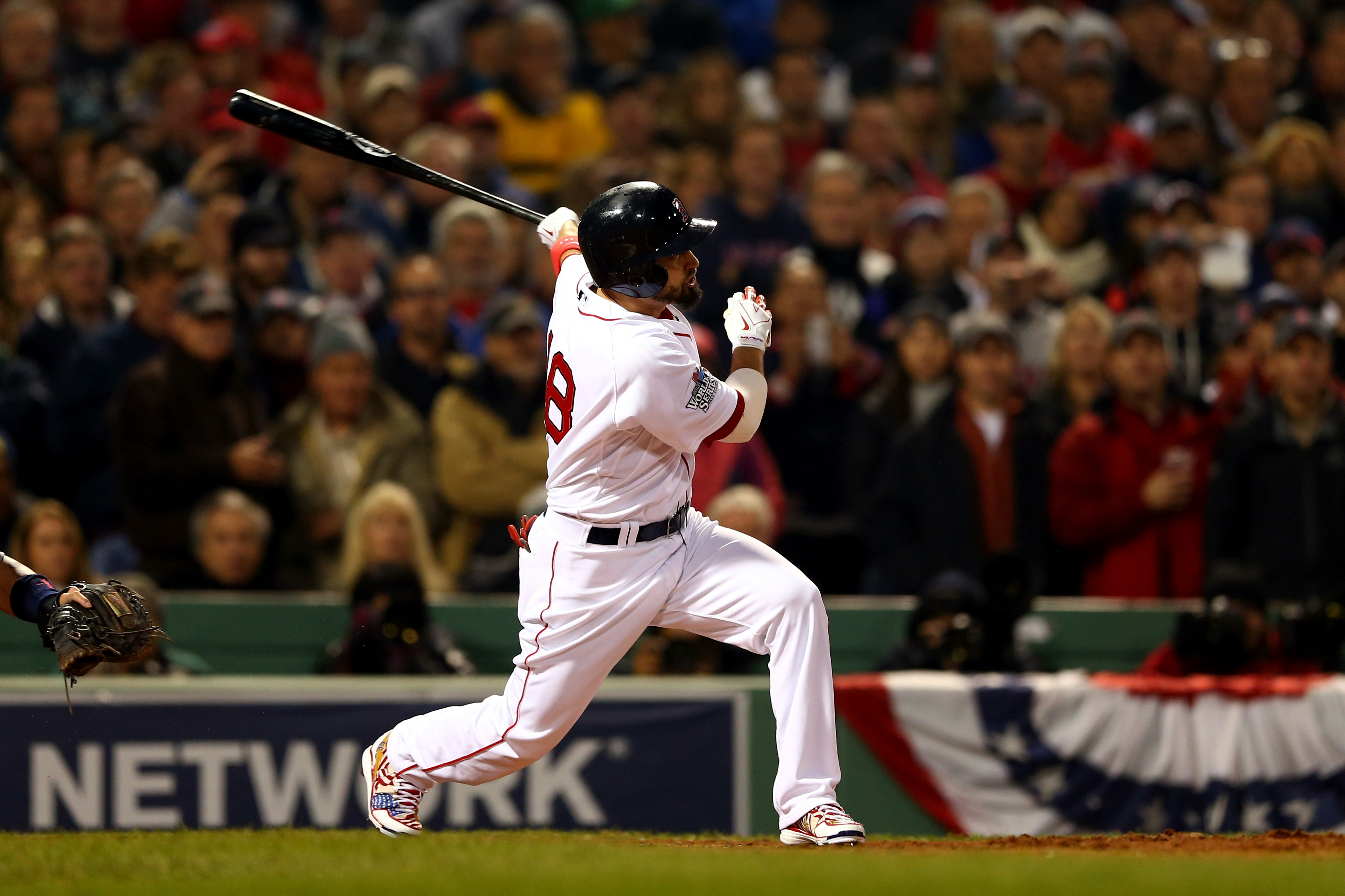 Boston's Shane Victorino strokes a ball high off the Green Monster with the bases loaded in the third, driving in the first three runs of Game Six. The Red Sox defeated the Cardinals, 6-1, to win the World Series 4-2 on Wednesday night.
