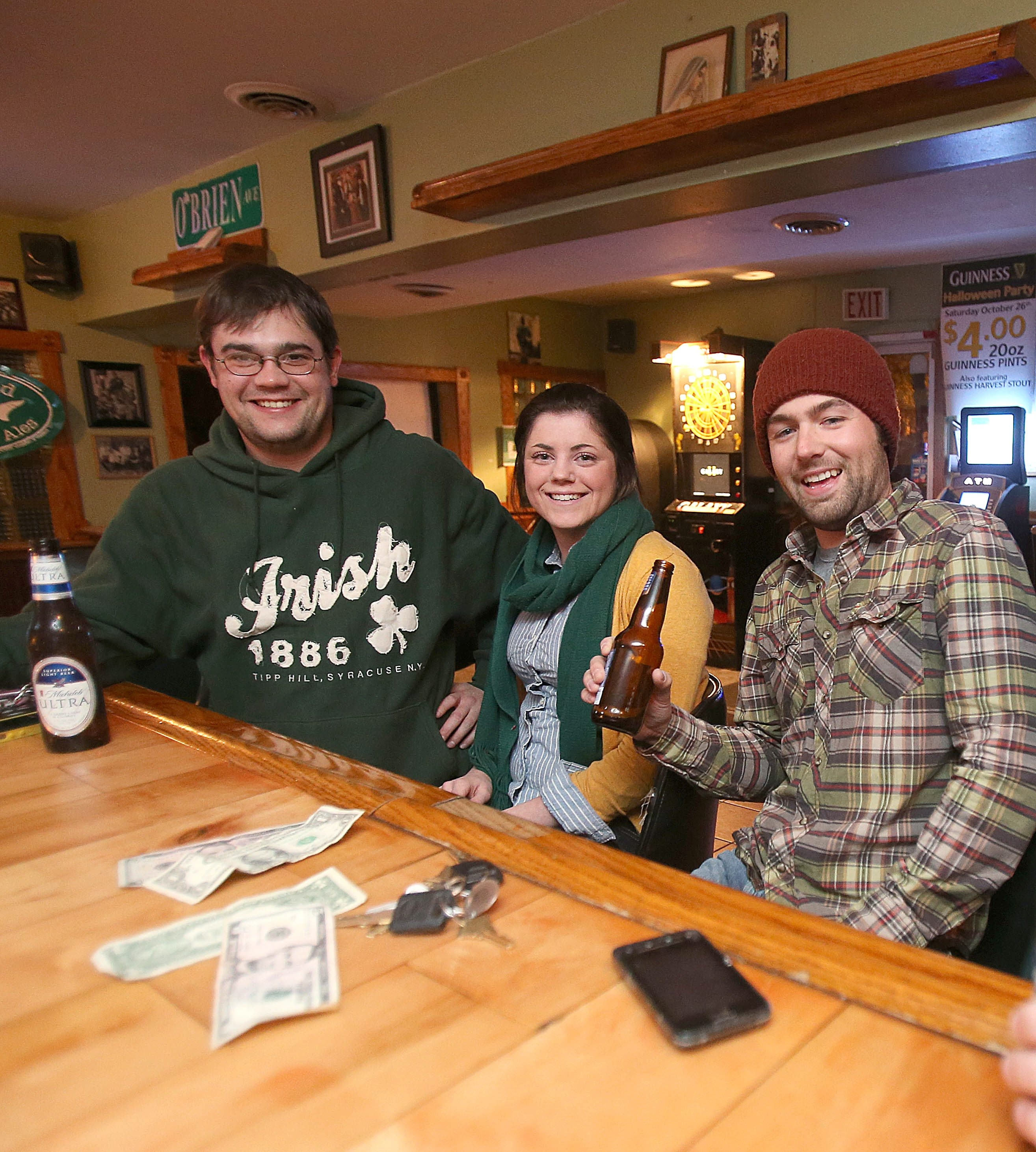 Jim Creahan, left, Mavourneen Kuebler and David Kraft enjoy good times and cool drinks at the Hop Inn in South Buffalo.