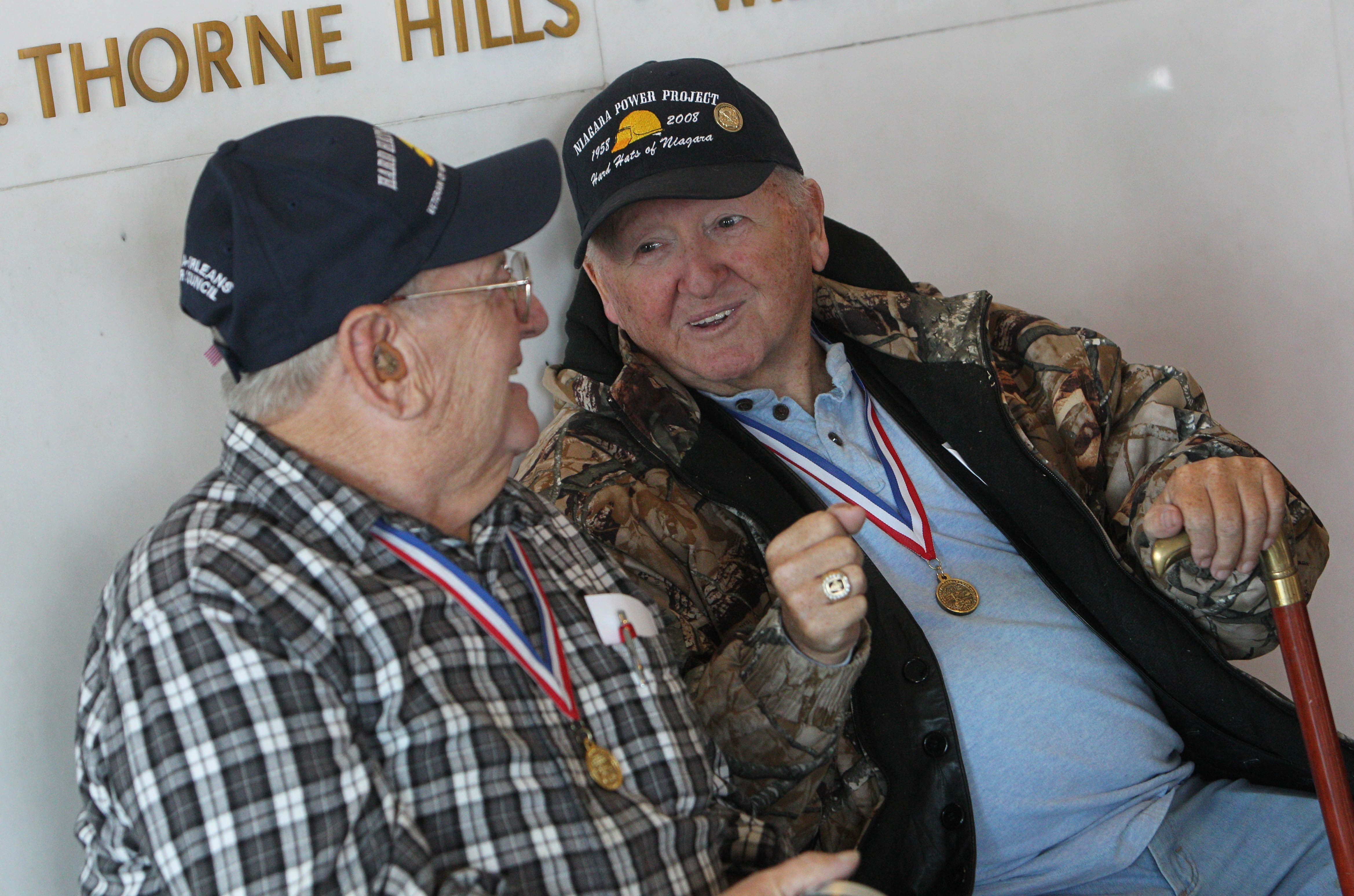 Bob Adner, 83, left, of Town of Tonawanda, and Gordon Botting, 74, of Lockport, members of the Hard Hats of Niagara, share stories of how they helped build Niagara Hydroelectric Power Station and the Power Vista in 1950s and early '60s.