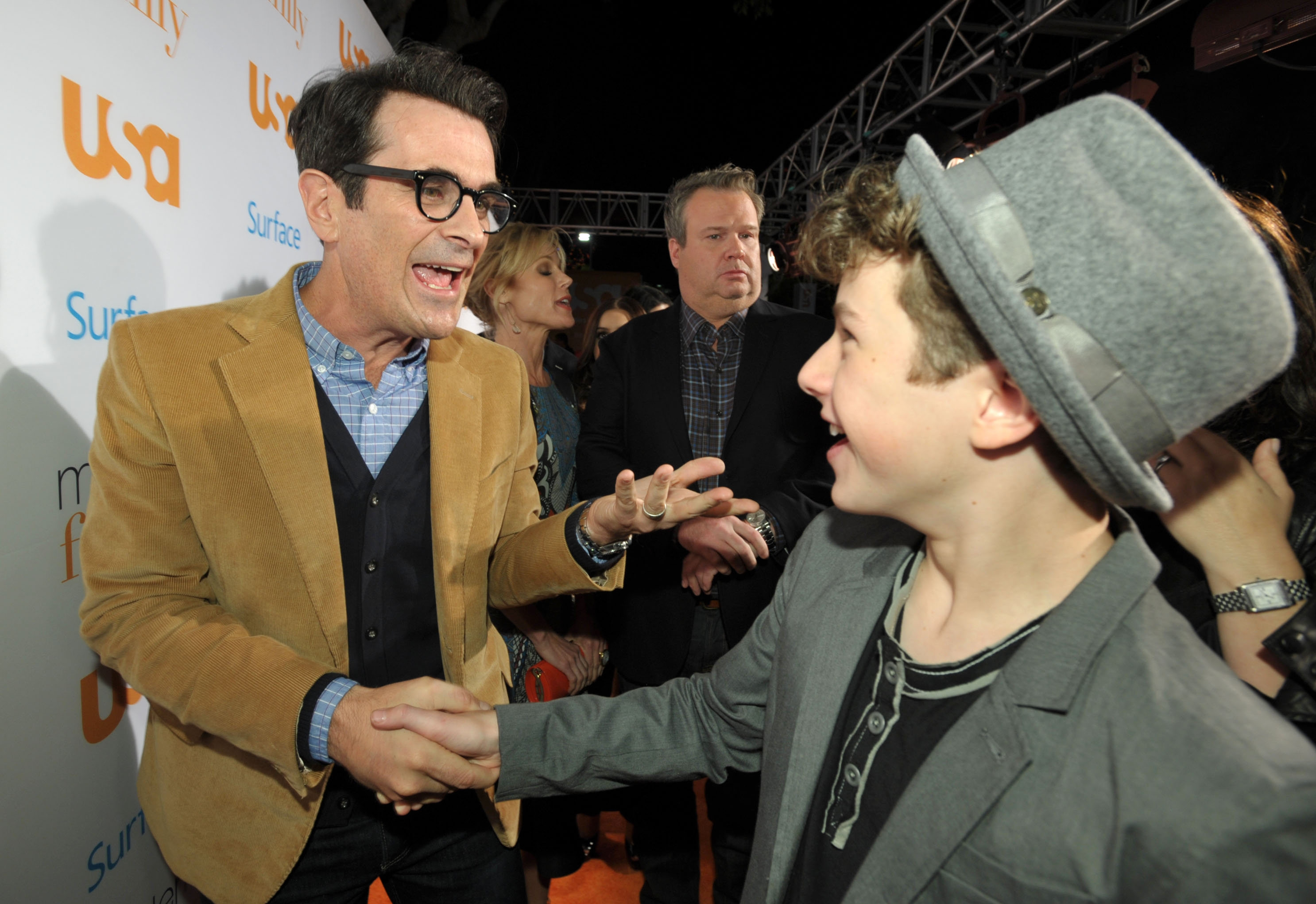 """Ty Burrell, who plays Phil on """"Modern Family,"""" and Nolan Gould, who plays Phil's son, Luke, greet each other at Fan Appreciation Day event Monday. The entire cast attended."""