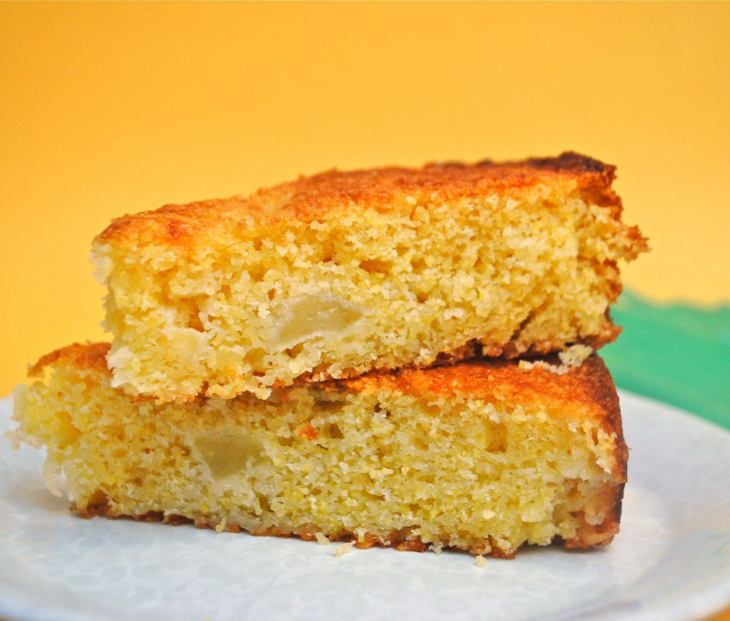 A diced Gala apple and some grated cheddar cheese give this rustic cake layers of seasonal flavor. Some cornmeal in the batter lends golden color and a little crunch.