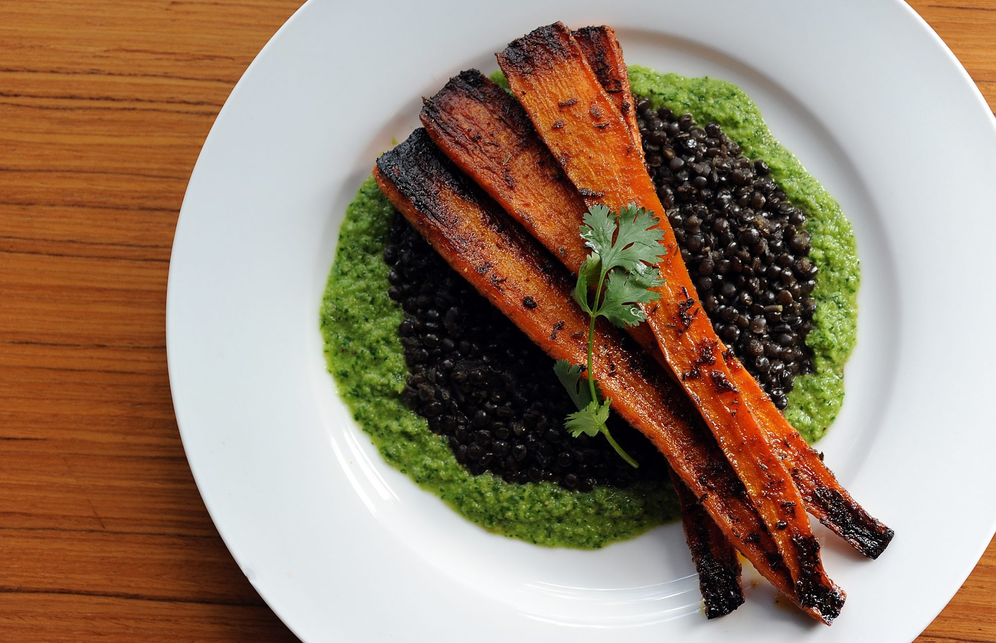 Roasted Carrots with Black Lentils and Green Harissa is a knife-and-fork dish, good for special occasions as well as weeknight dining.
