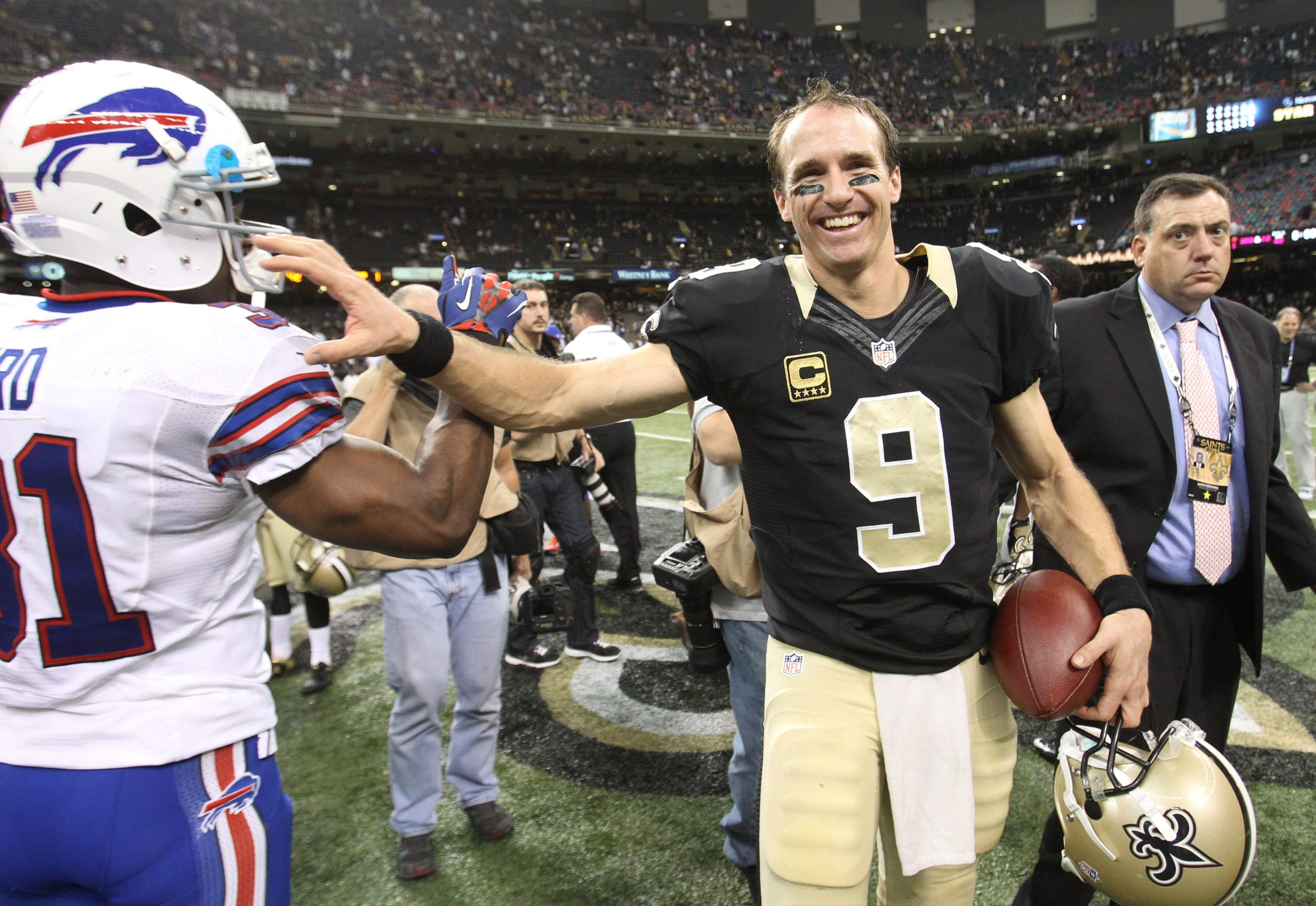 Saints quarterback Drew Brees shares a joke with Bills free safety Jairus Byrd after a five-touchdown game.