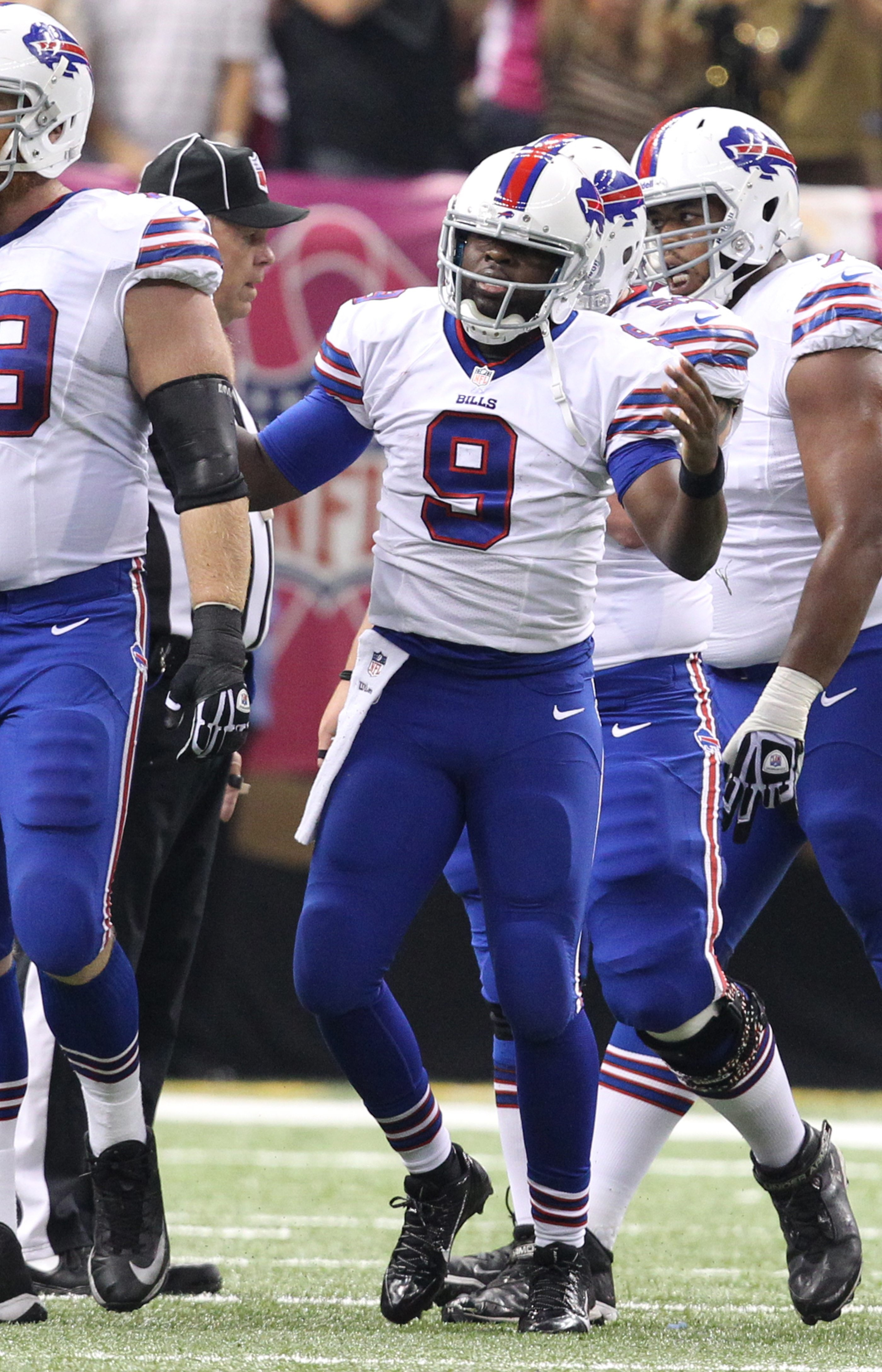 Buffalo Bills quarterback Thad Lewis (9) gestures to the sideline after fumbling in the first quarter. He fumbled three times against the Saints, losing two.  (James P. McCoy/ Buffalo News)